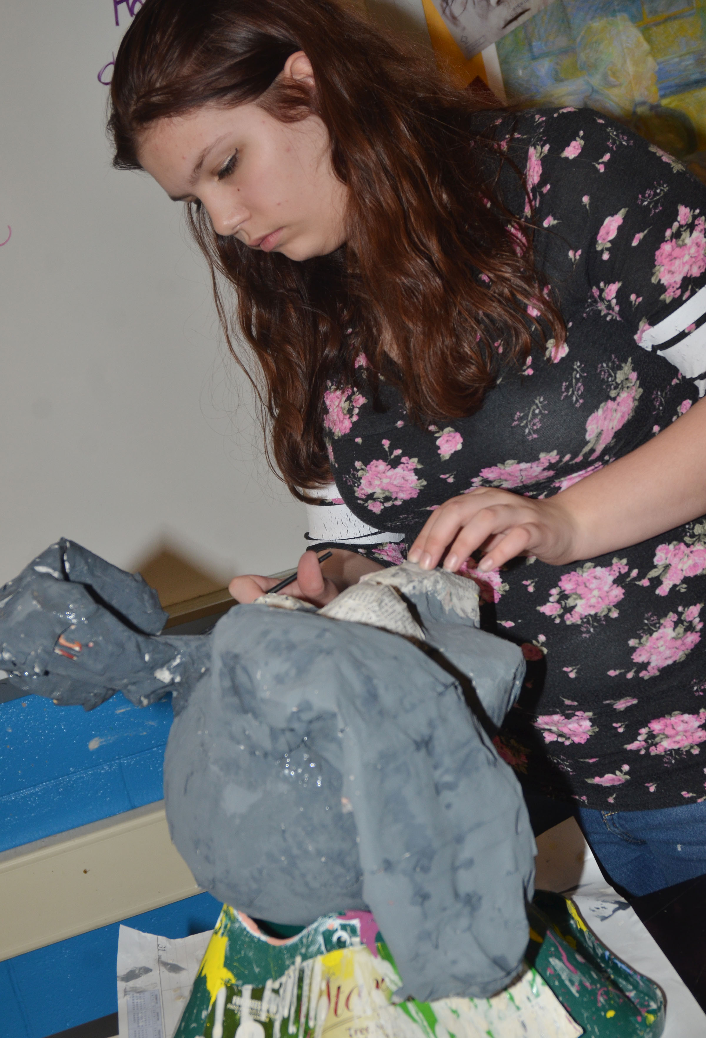 CHS freshman Shelby Hunt paints her paper mache sculpture.