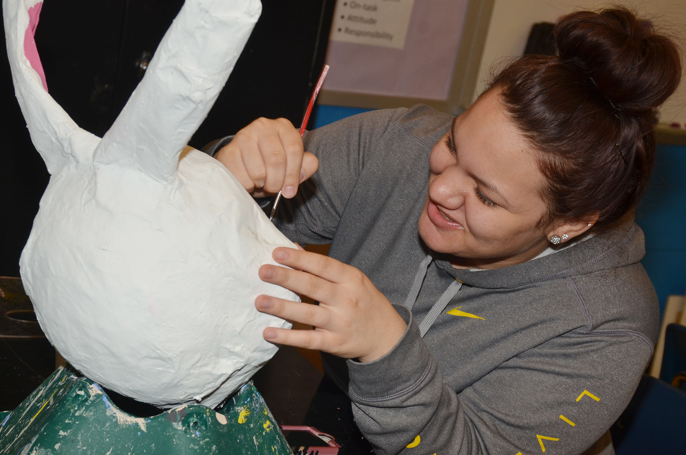 CHS junior Jayden Bridgewater paints her paper mache sculpture.