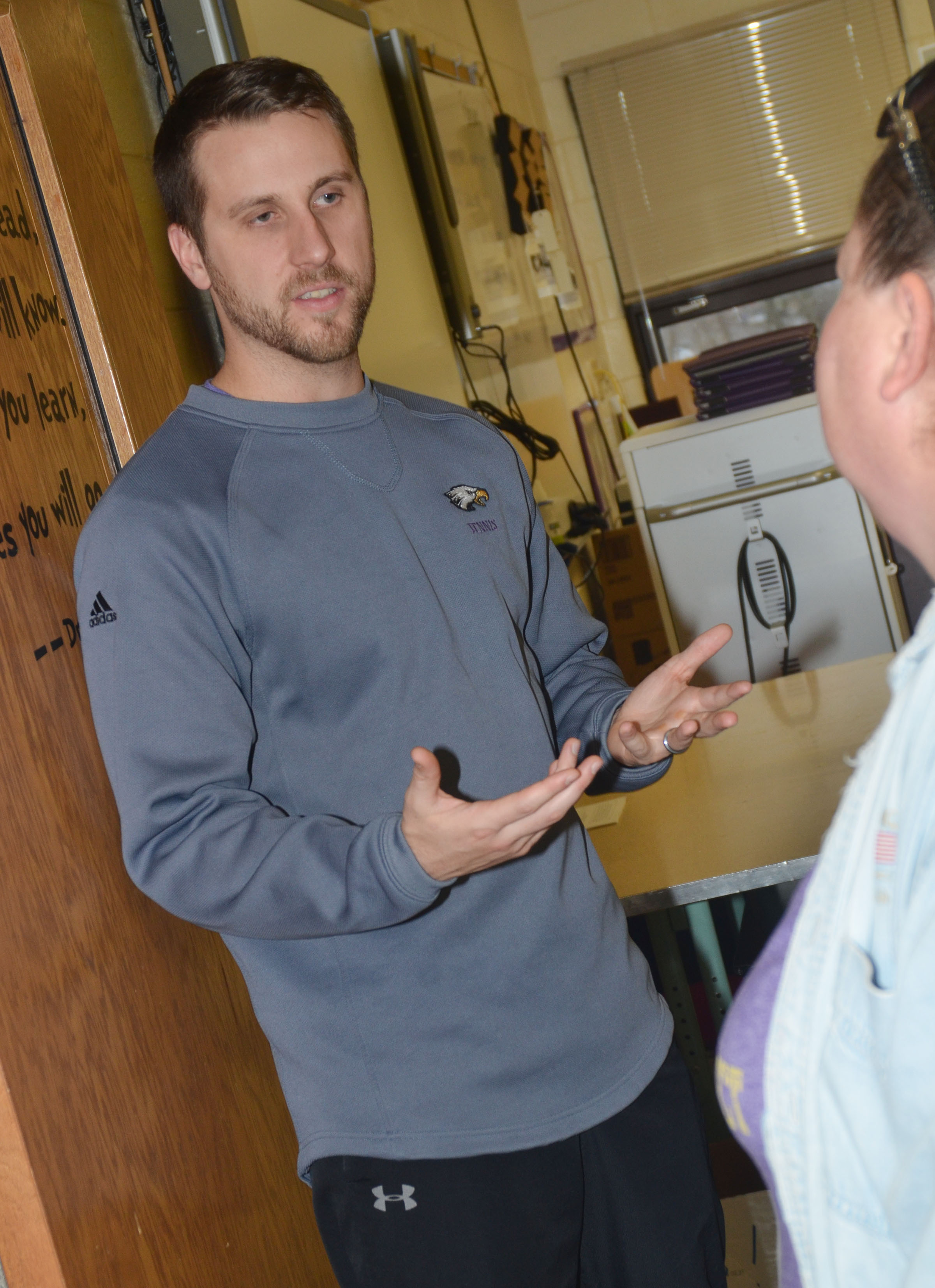 CHS teacher Tyler Hardy meets with a parent.