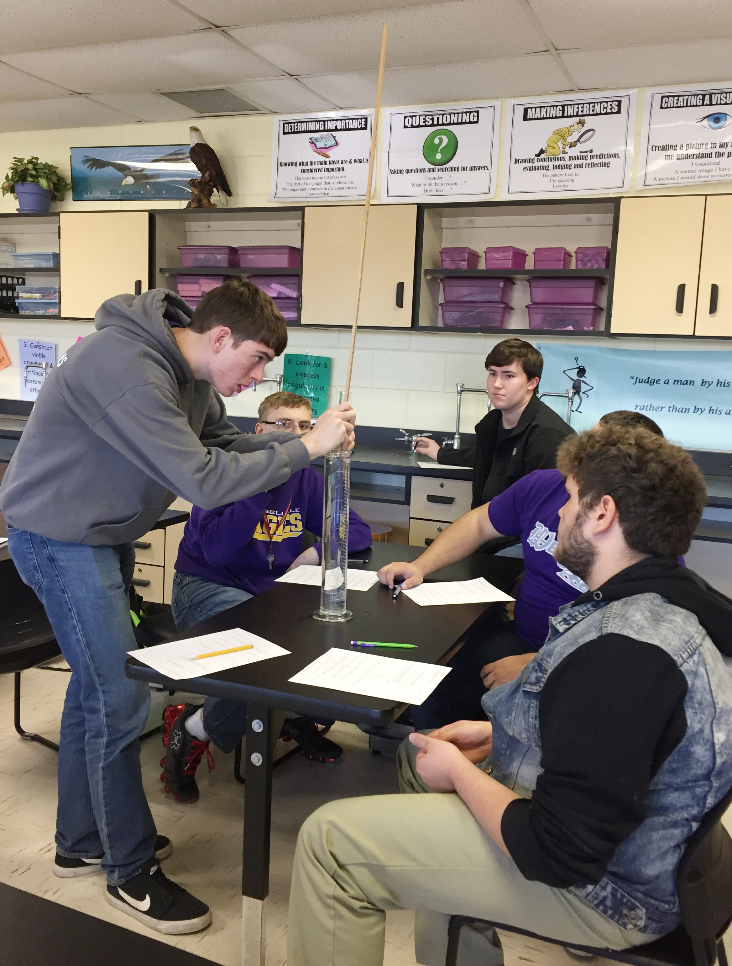CHS senior Murphy Lamb and his classmates, clockwise from left, Ben Rafferty, Zack Settle, Logan Brown and Dalton Ballentine work to determine the speed of sound.