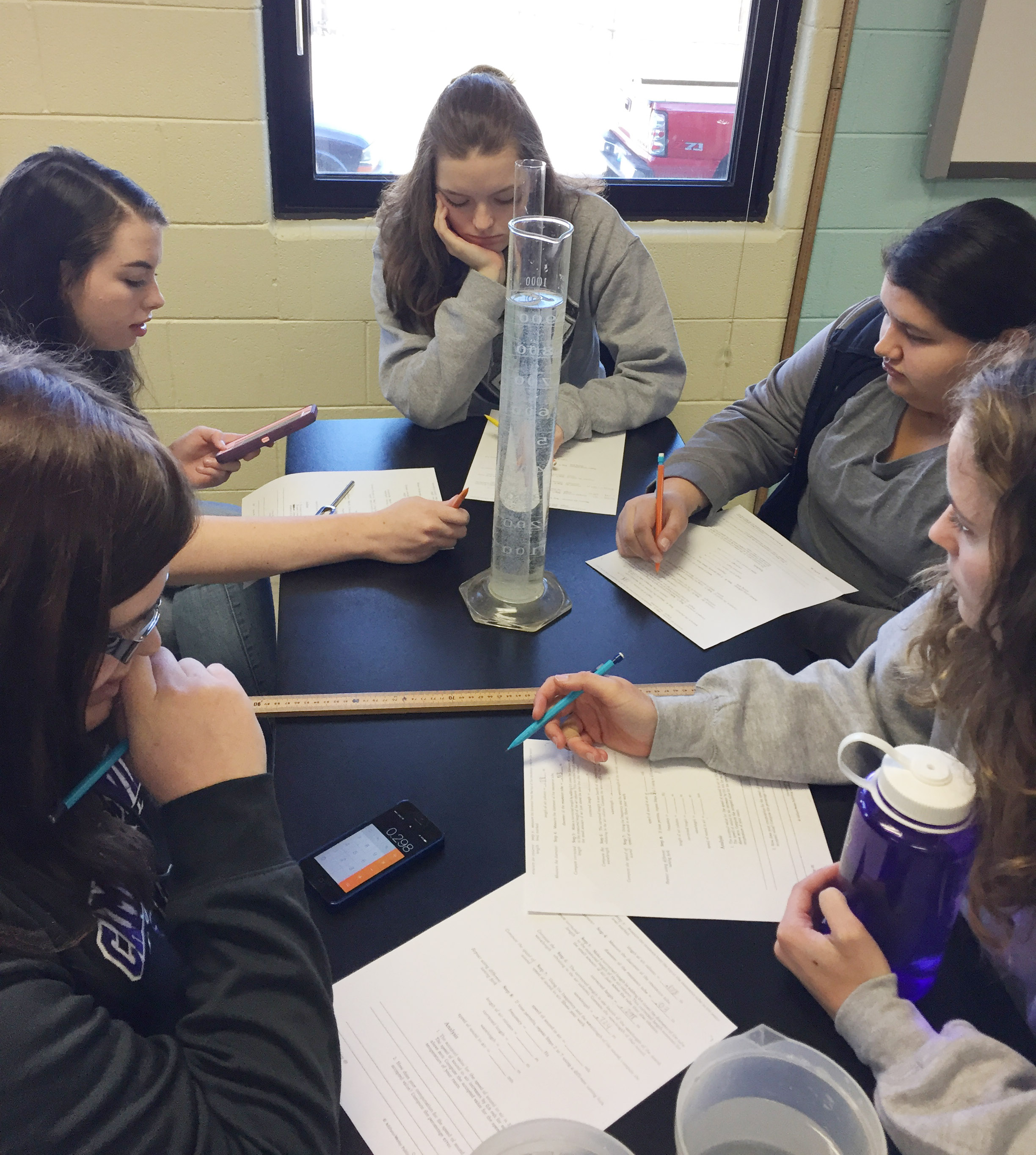 Clockwise from left, Vera Brown, Laura Lamb, Blair Lamb, Laura May Gutierrez and Caroline McMahan work together to determine the speed of sound.