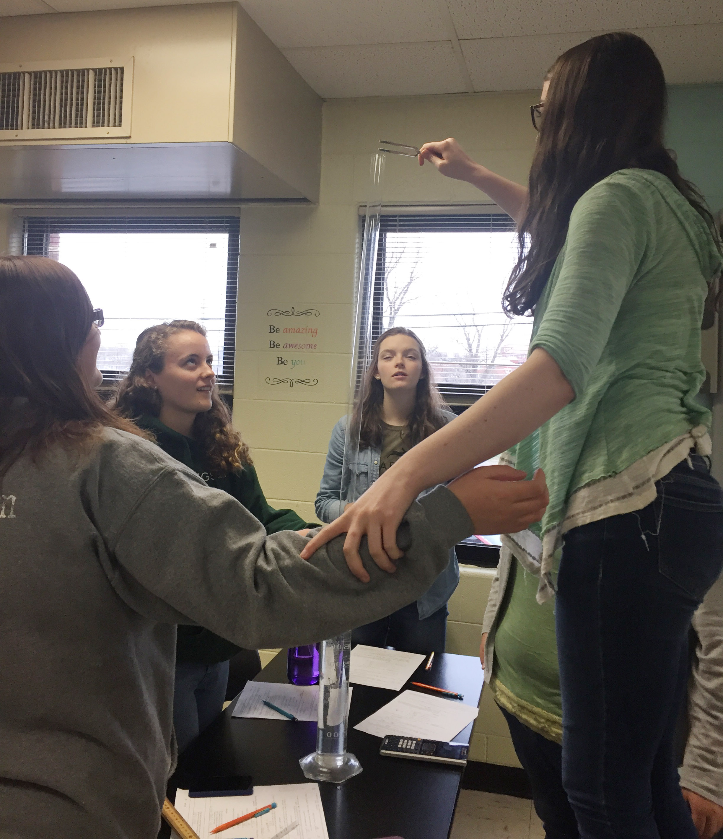 CHS senior Laura Lamb and her classmates work together to determine the speed of sound.
