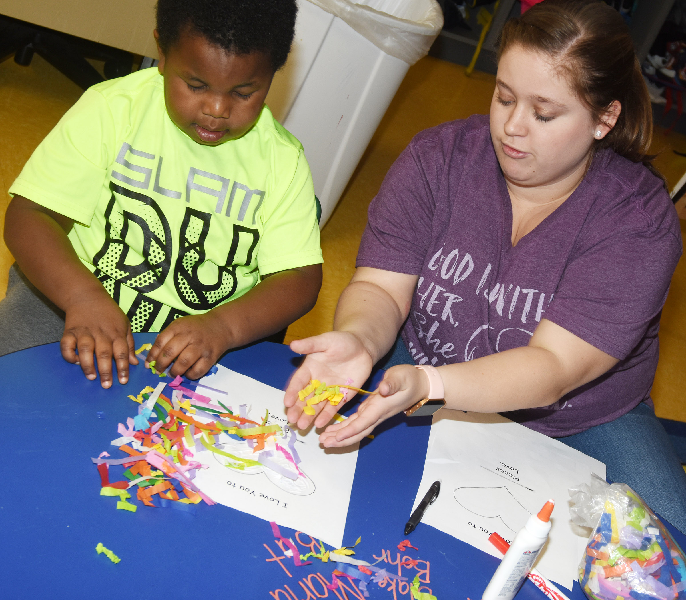 CES preschool student Kareem Smith decorates a Valentine card, with help from Campbellsville University education student Jordyn Bray.