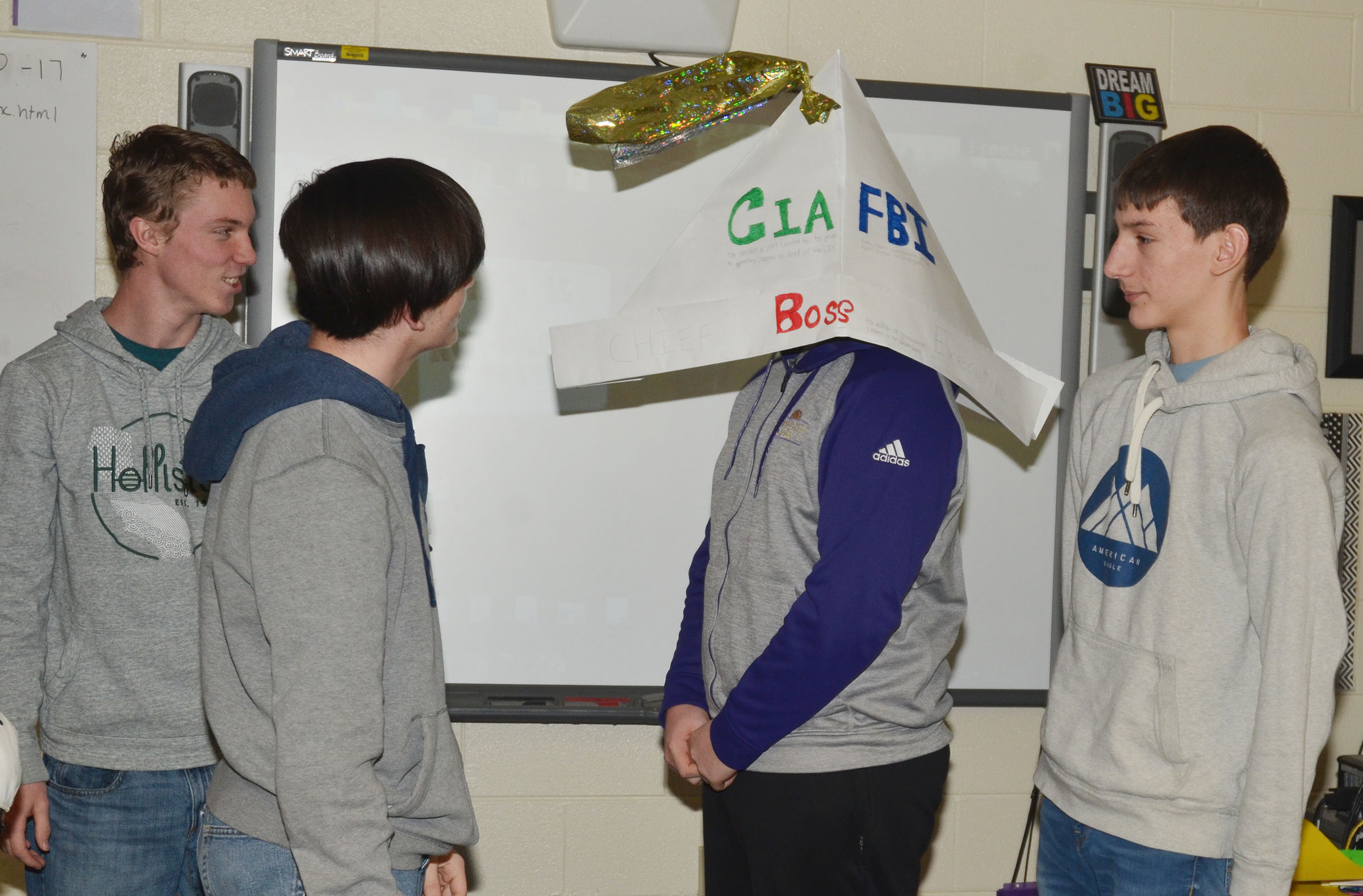 CHS sophomore Spencer Swafford wears his group's presidential hat as his classmates discuss their project. From left are sophomores Payton Reynolds, Cameron Bohannon and Evan McAninch.