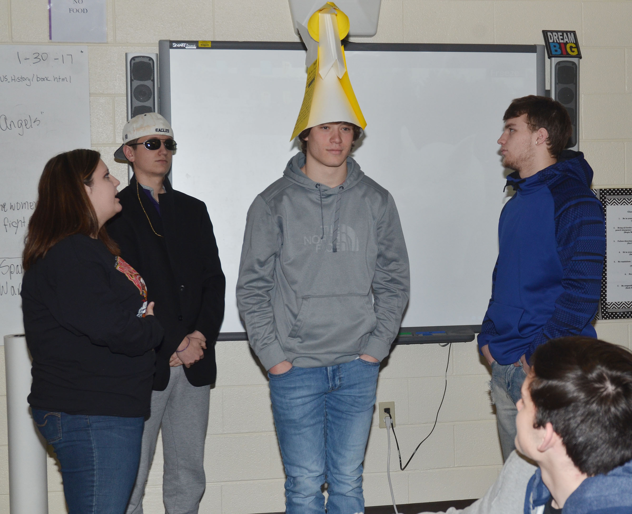 CHS sophomore Tristan Johnson wears his group's presidential hat as his group members, from left, Andrea Bryant, Myles Murrell and Dakota Reardon discuss it.