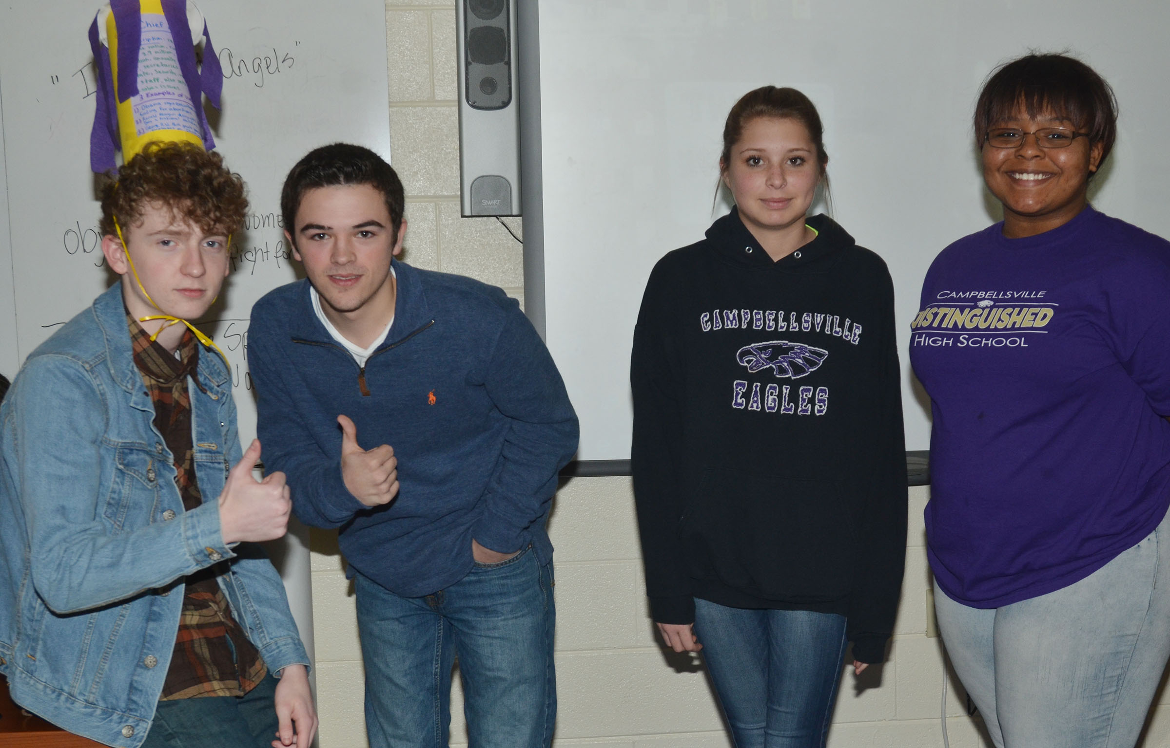 From left, CHS sophomores Jackson Hinton, Ryan Kearney, Chloe Gupton and Natalie Caldwell model their presidential hat.