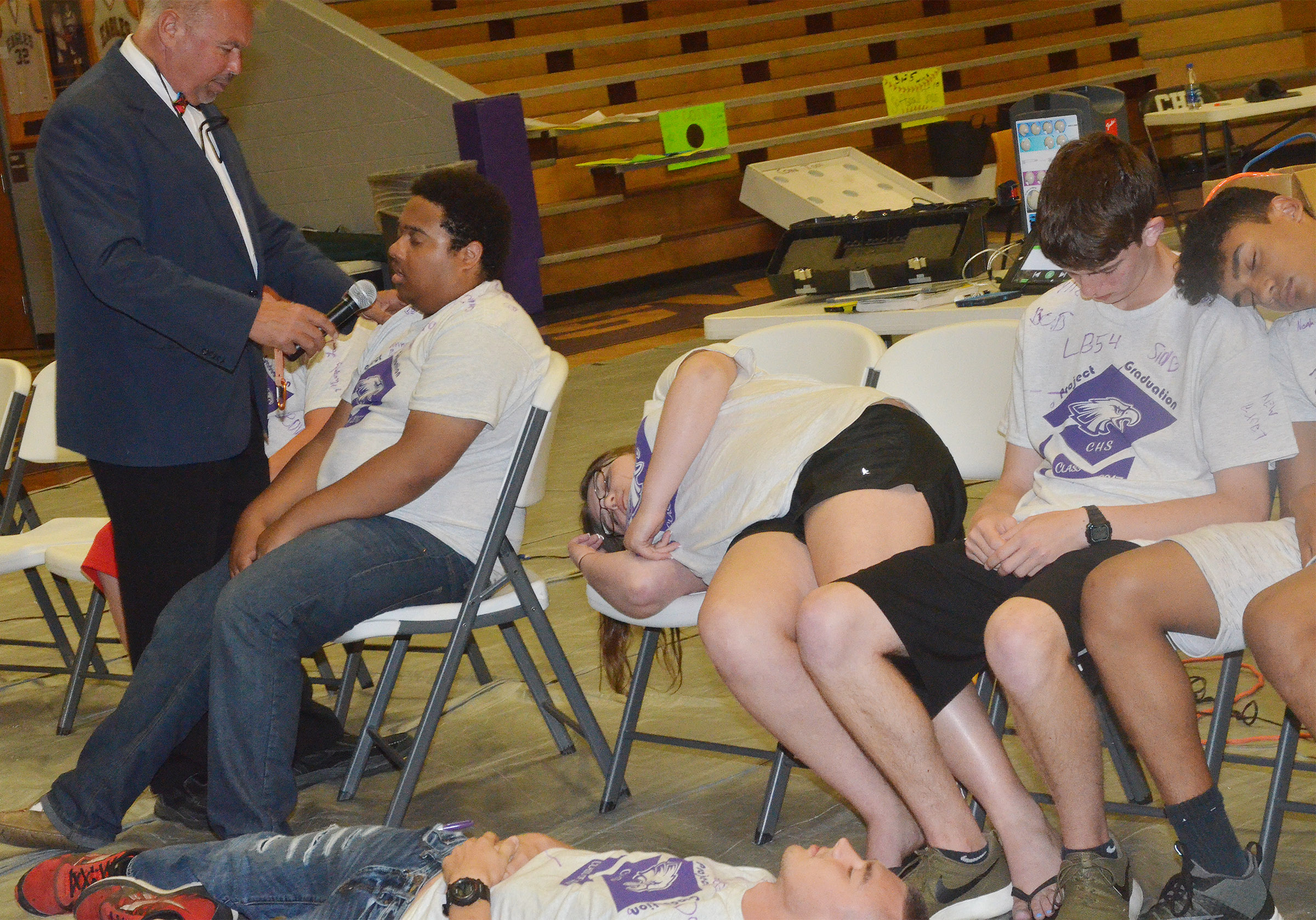 CHS senior Ricky Smith-Cecil talks to his classmates while under hypnosis.