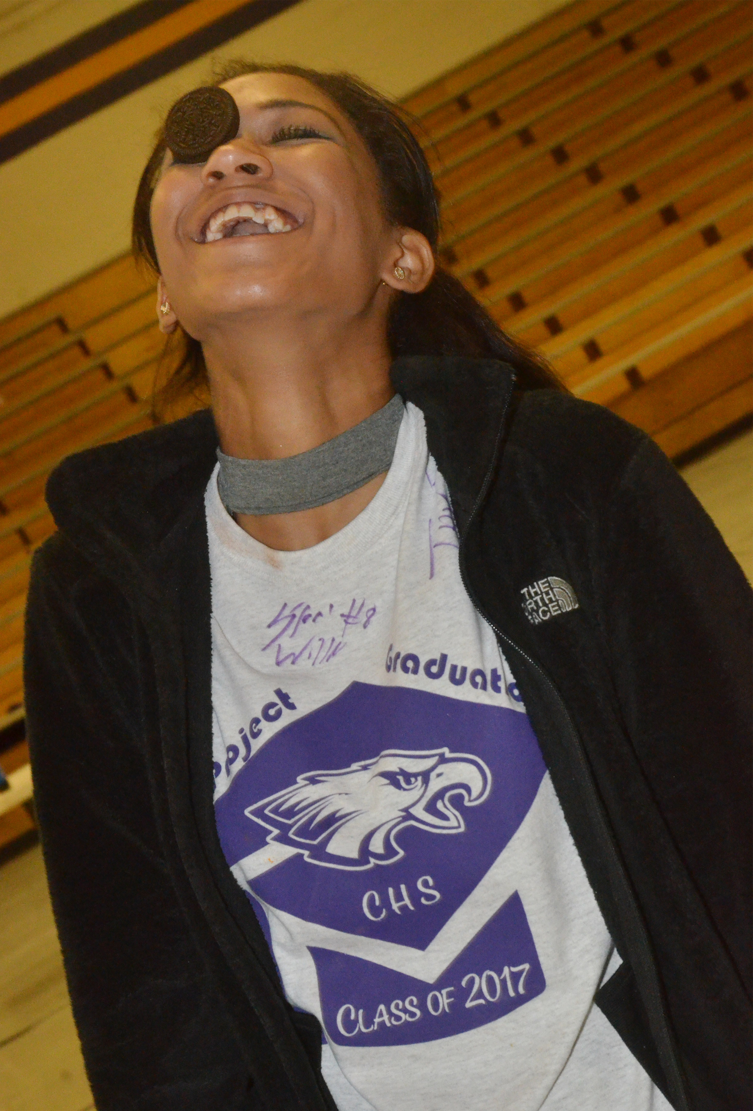 CHS senior Alexis Shears tries to get a cookie from her forehead into her mouth.