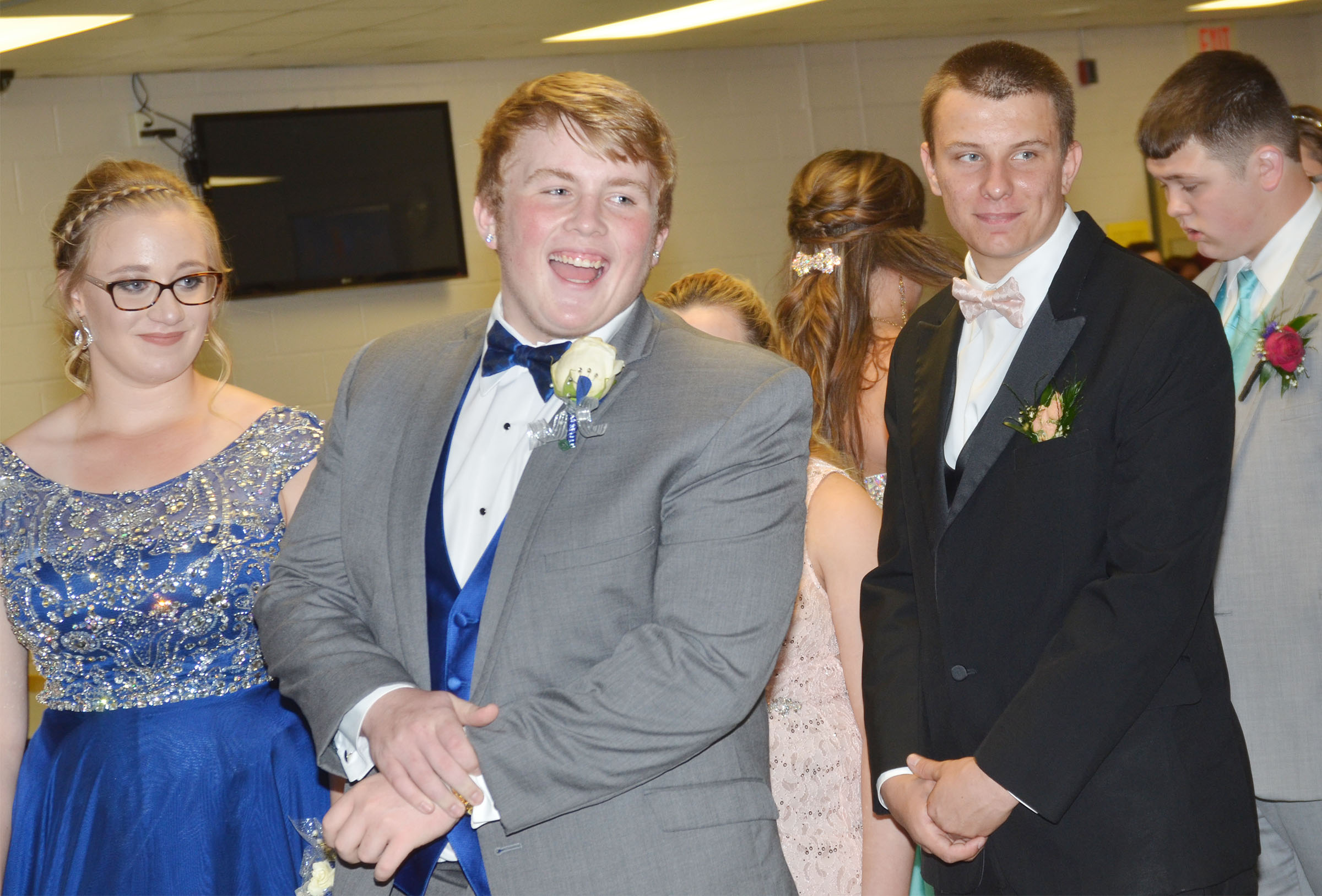 CHS junior Ryan Jeffries talks with his friends as he and his date, CHS freshman Samantha Johnson, wait to have their photo taken.