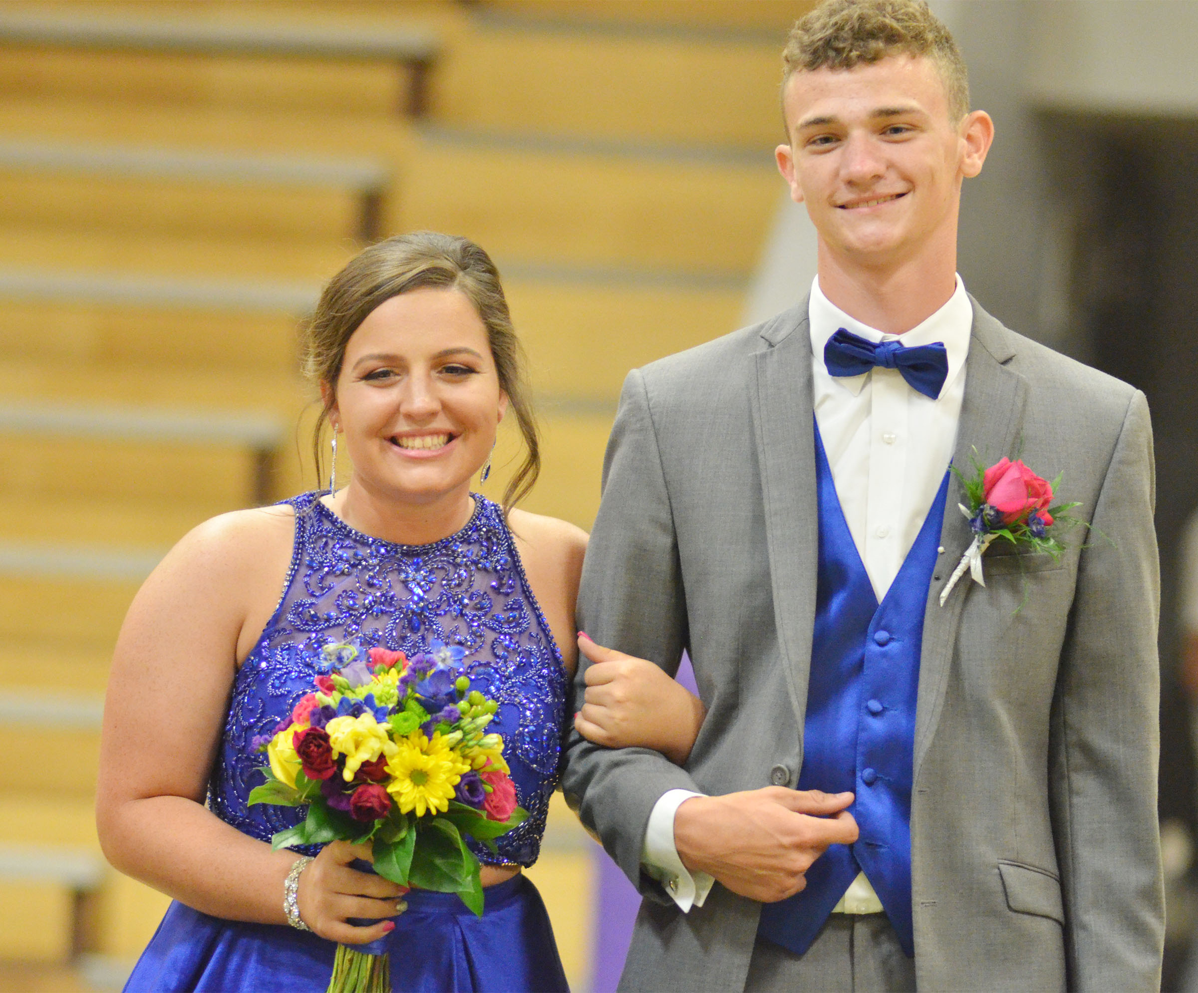 CHS juniors Caitlin Bright and Connor Wilson smile at prom walk.