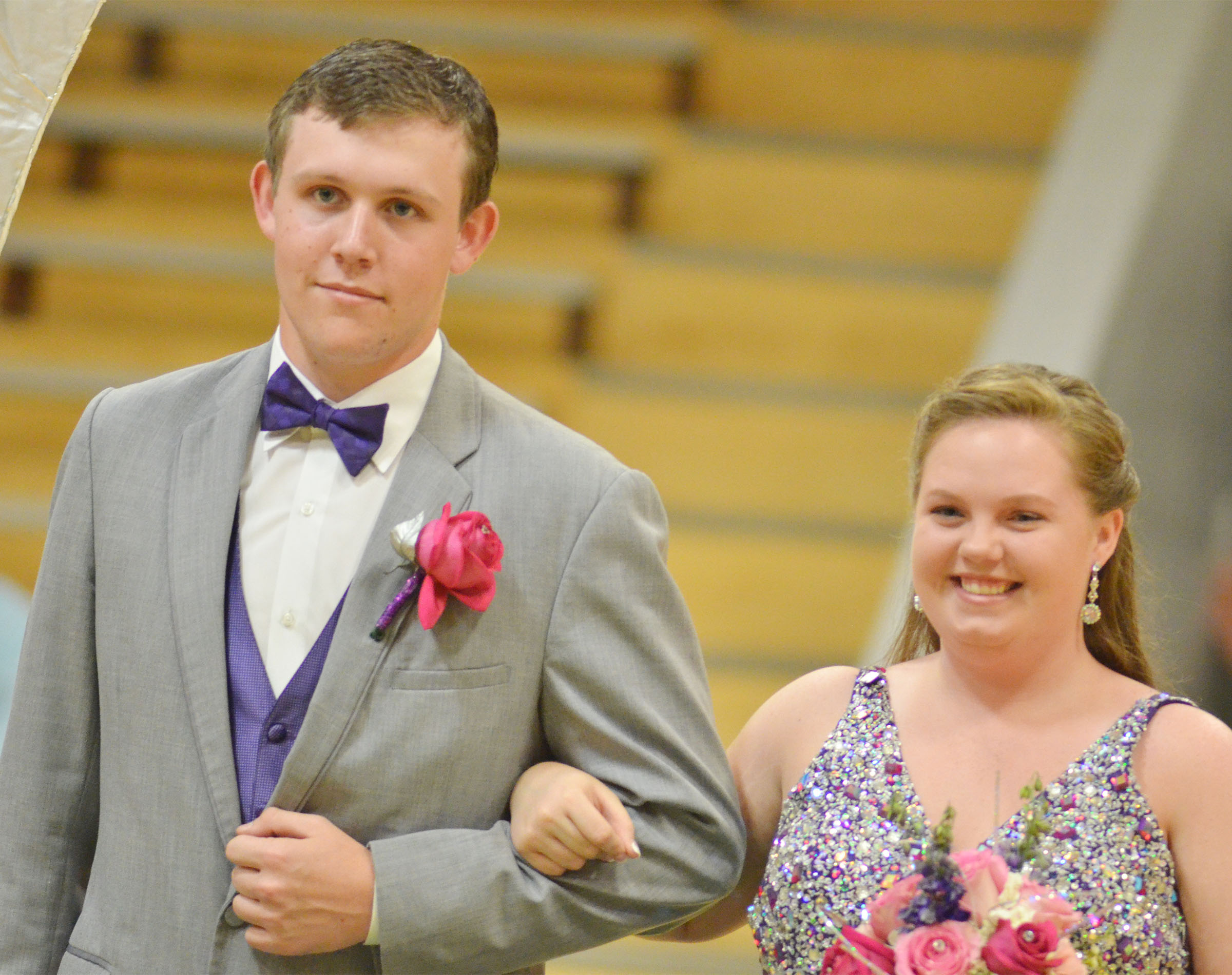CHS seniors Jared Brewster and Madison Lewis smile at prom walk.