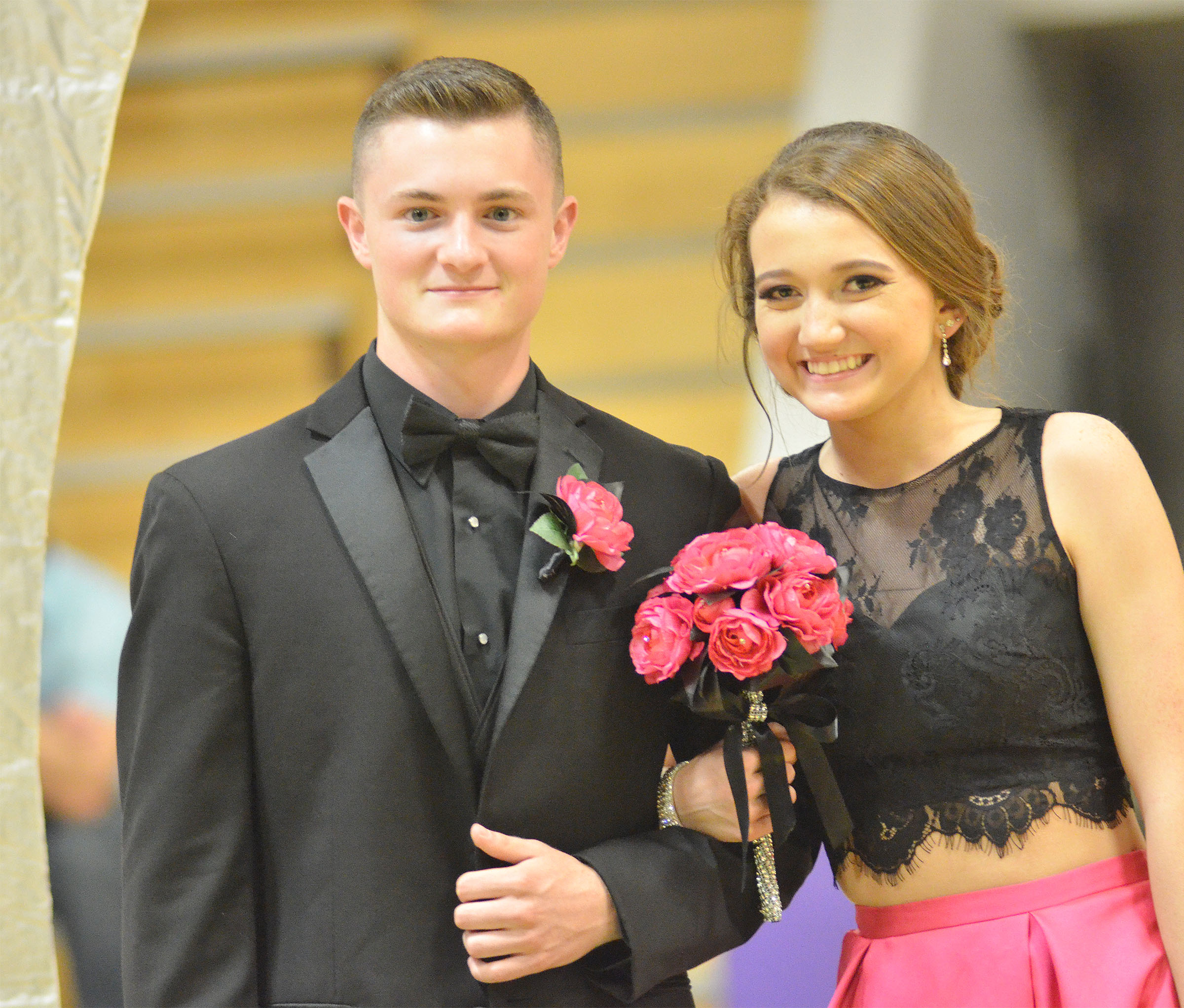 CHS junior Bryce Richardson and sophomore Salena Ritchie smile at prom walk.