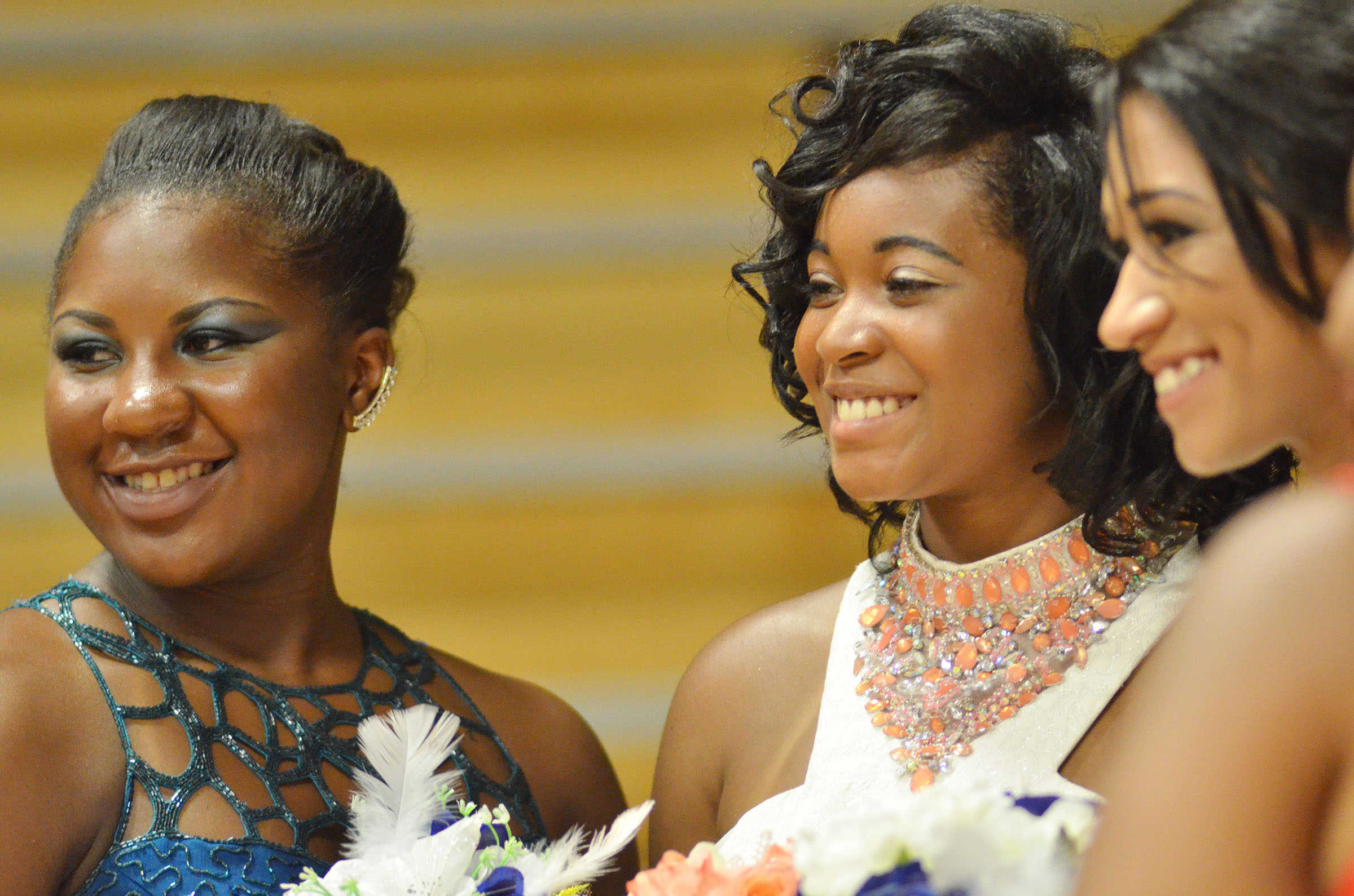 From left, CHS juniors Kiyah Barnett and Vonnea Smith and senior Alexis Shears smile for a photo at prom walk.