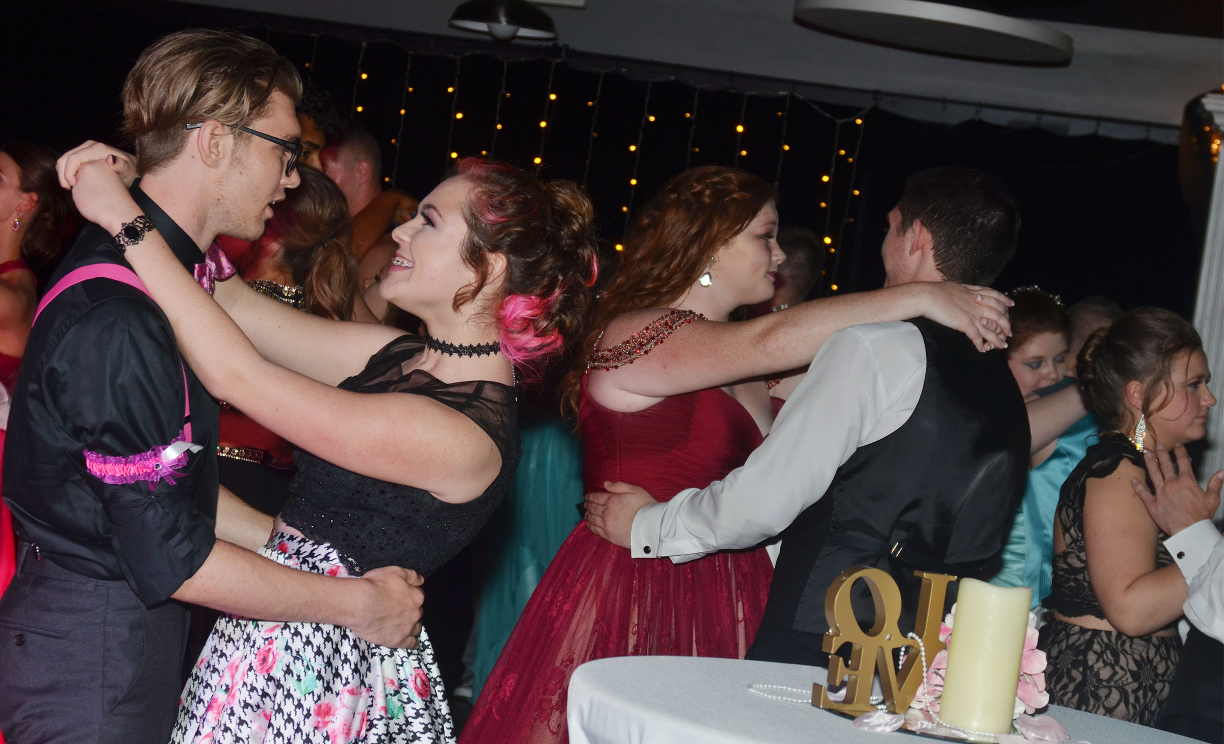 CHS junior Christian Berry and his date Jesslynne Mann and their classmates dance at prom.