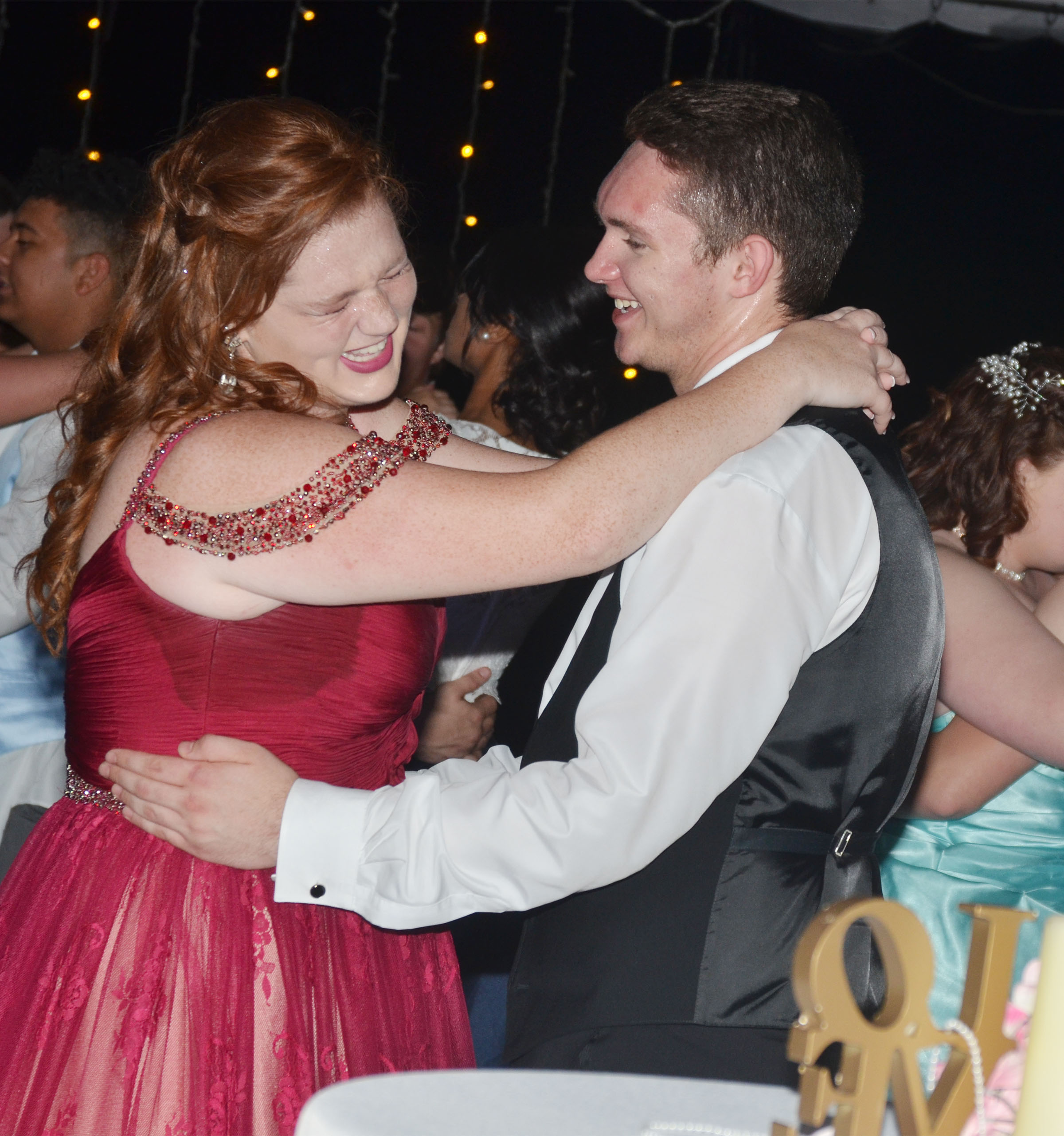 CHS senior Mallory Haley and Gatton Academy student Samuel Kessler share a laugh at prom.