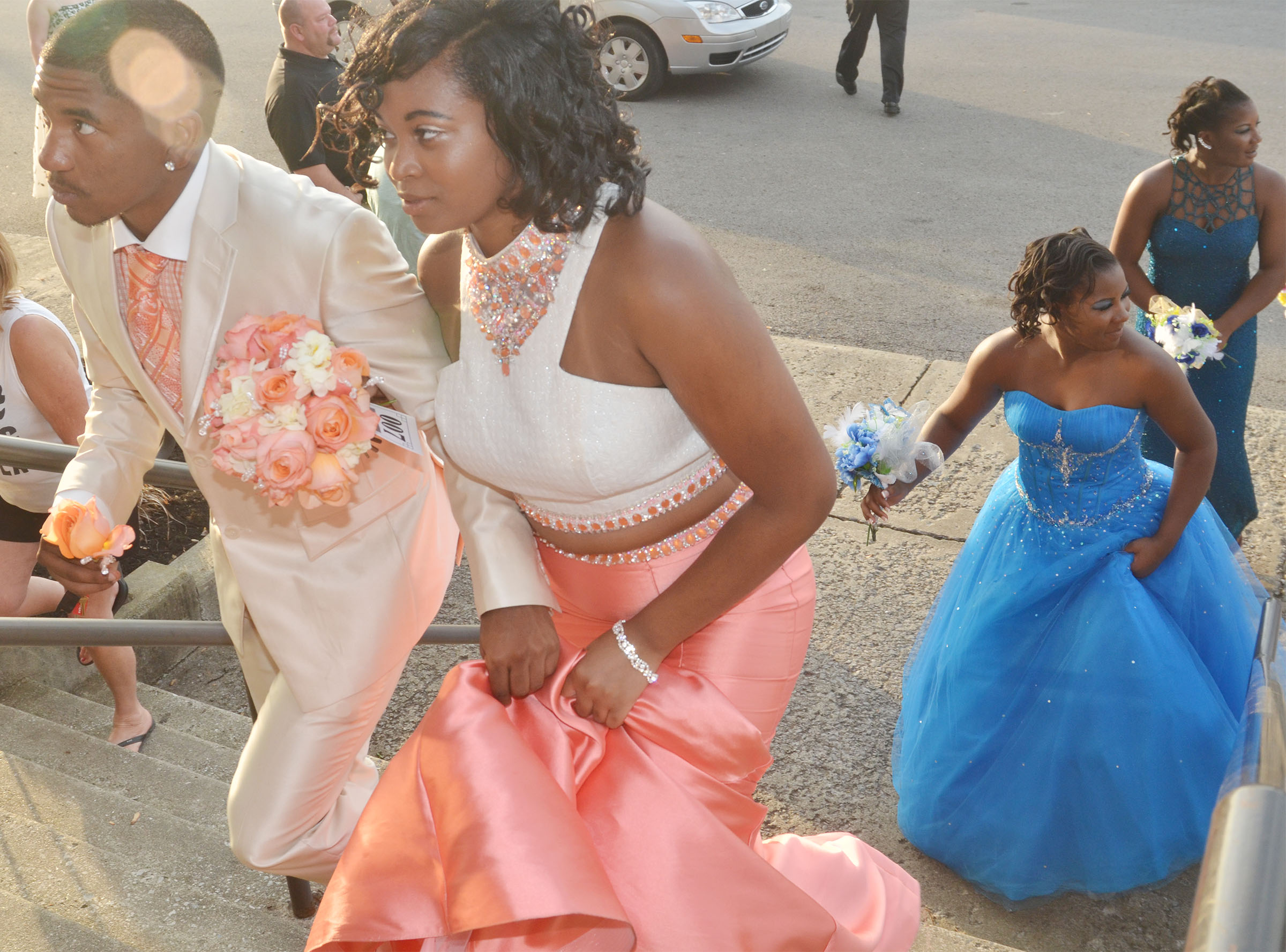 CHS juniors Tyrion Taylor, at left, and Vonnea Smith walk into CHS for prom walk.