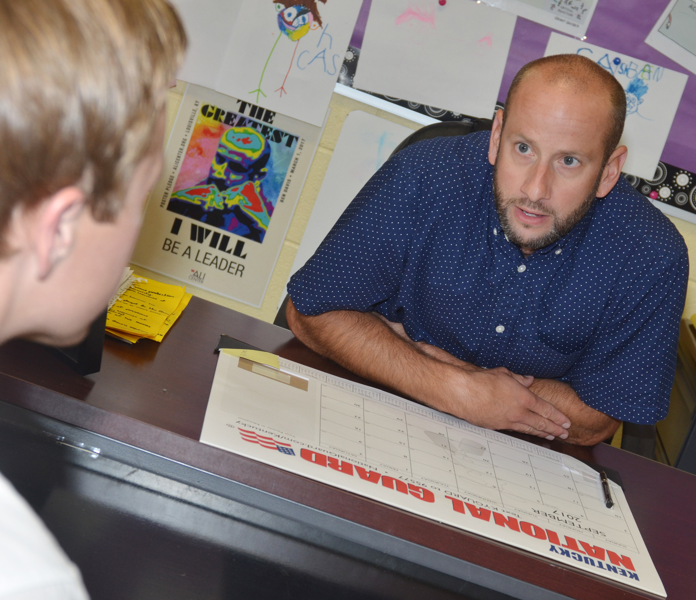 CHS teacher Ben Davis meets with a parent.