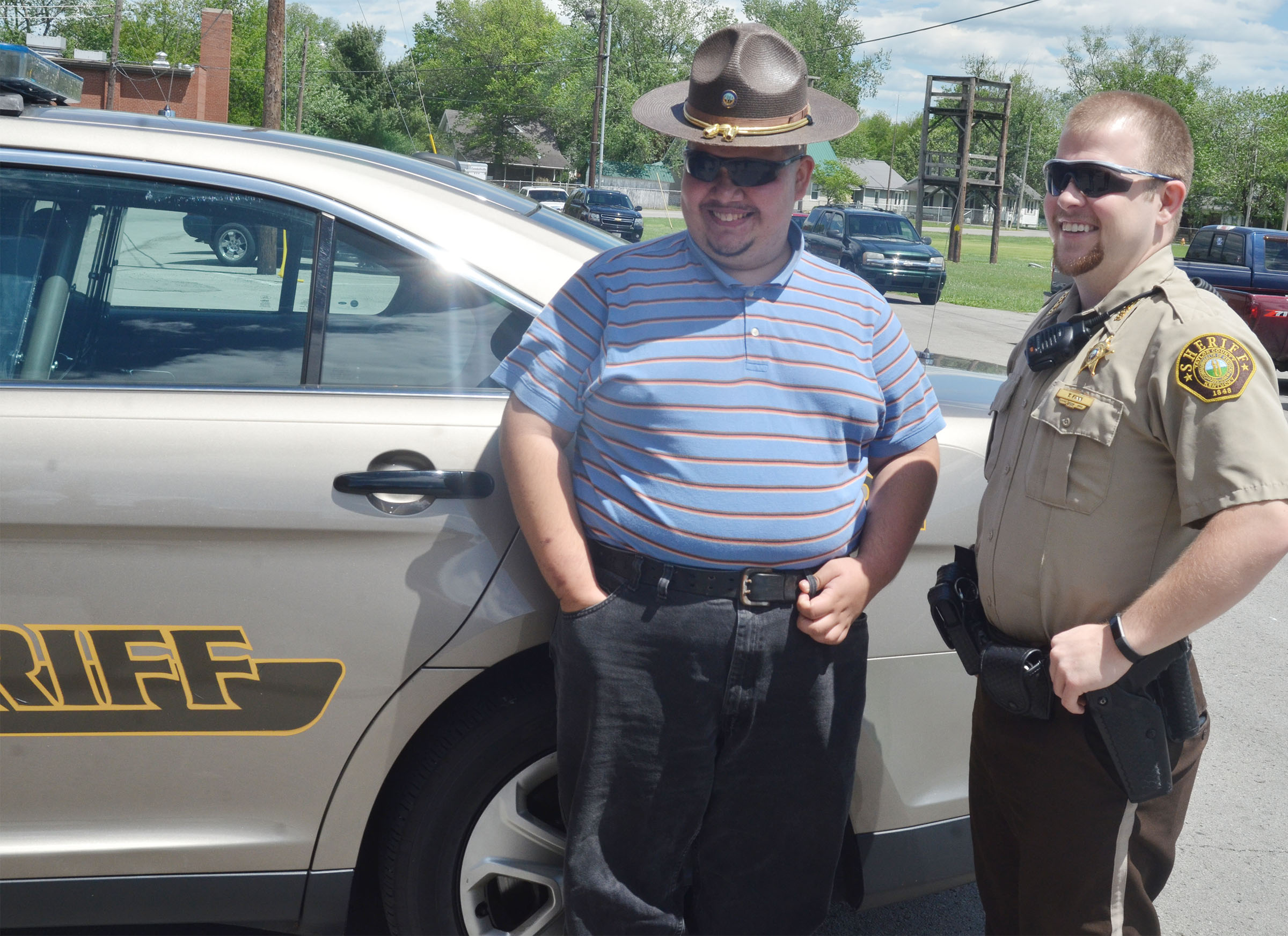 CHS senior Robert Tungate tries on Taylor County Sheriff's Deputy Tyler Finn's hat.