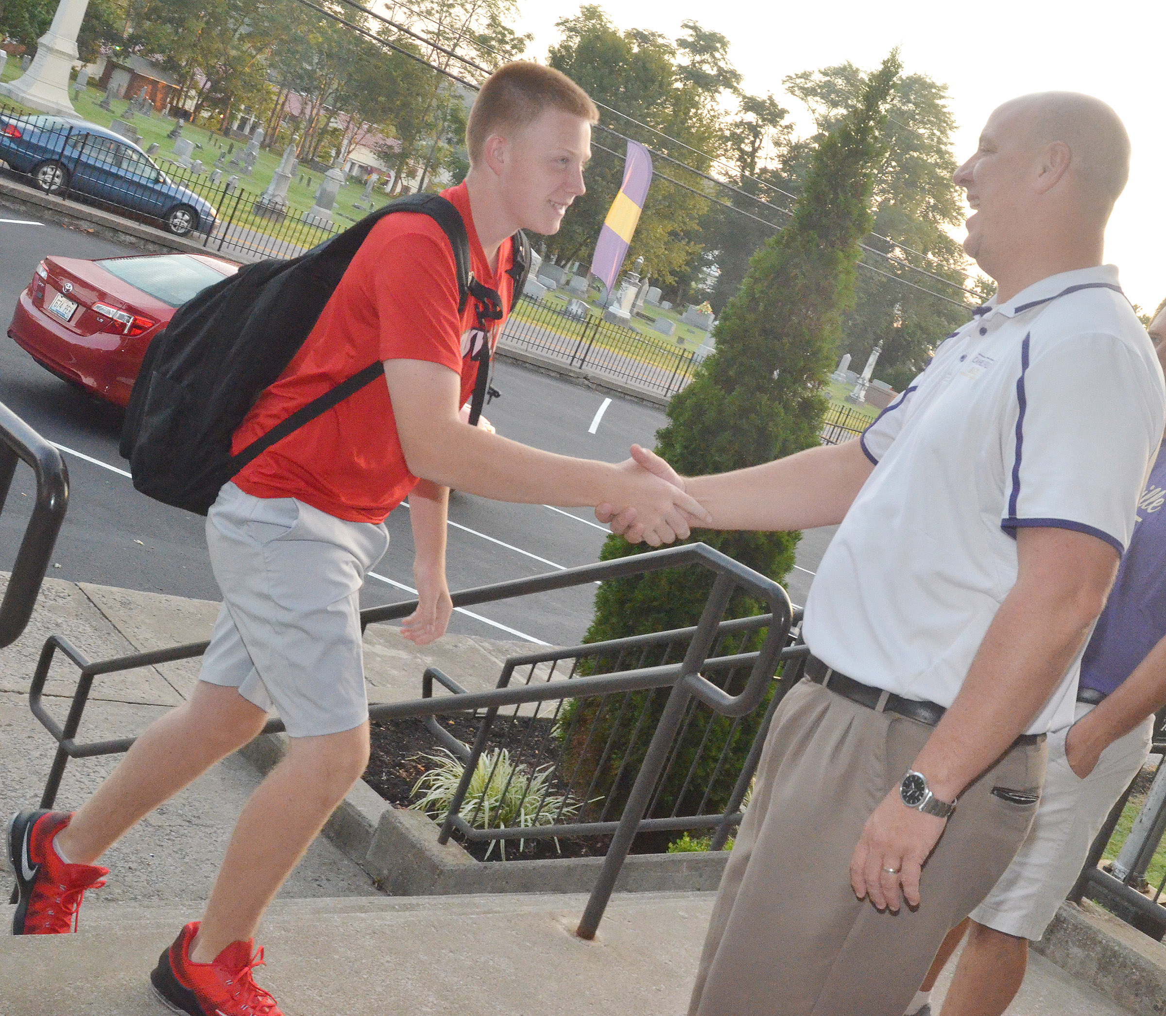 CHS Principal David Petett greets Patrick Walker on his third day of his sophomore year.