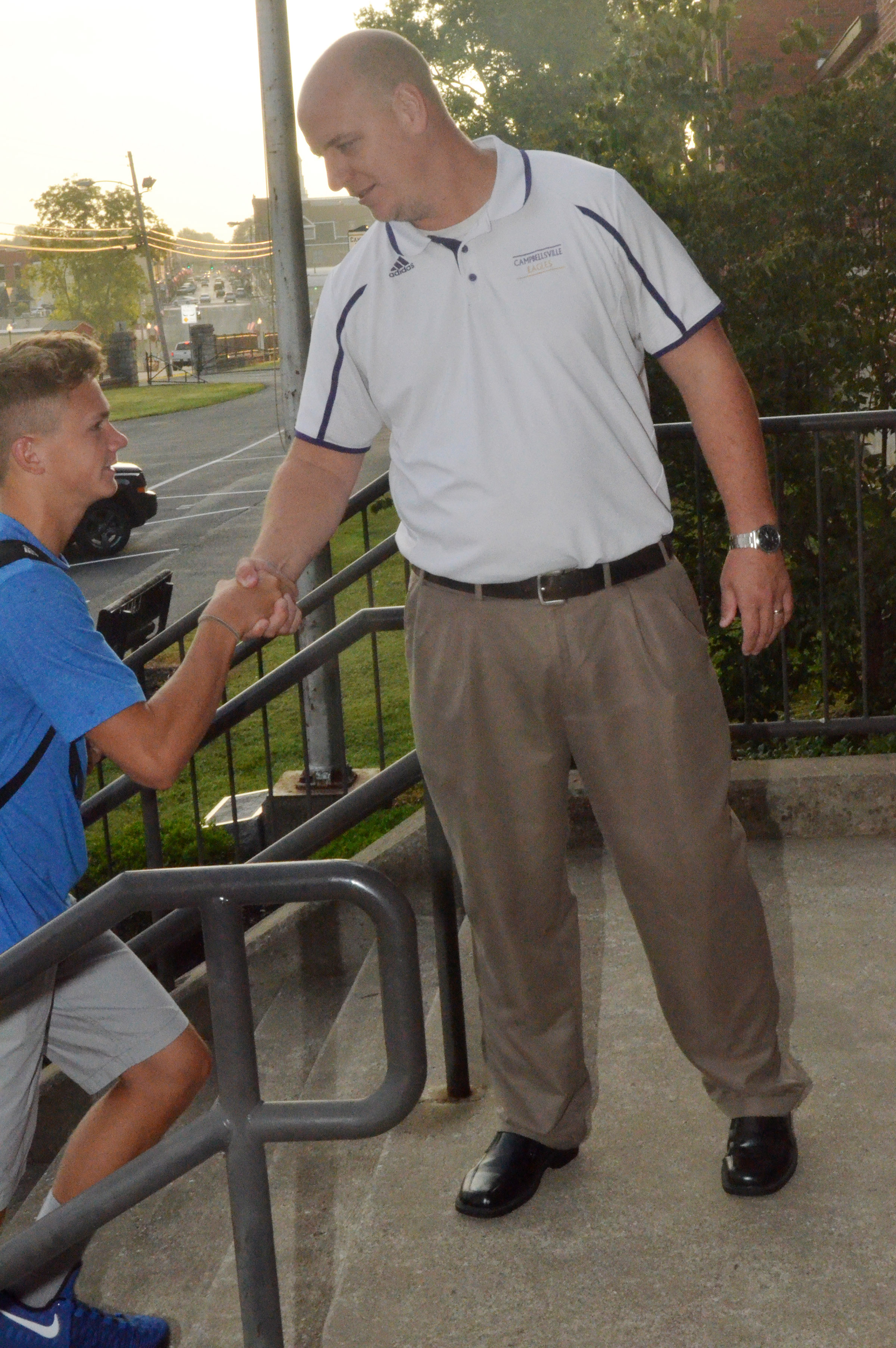 CHS Principal David Petett greets Blase Wheatley on the third day of his freshman year.