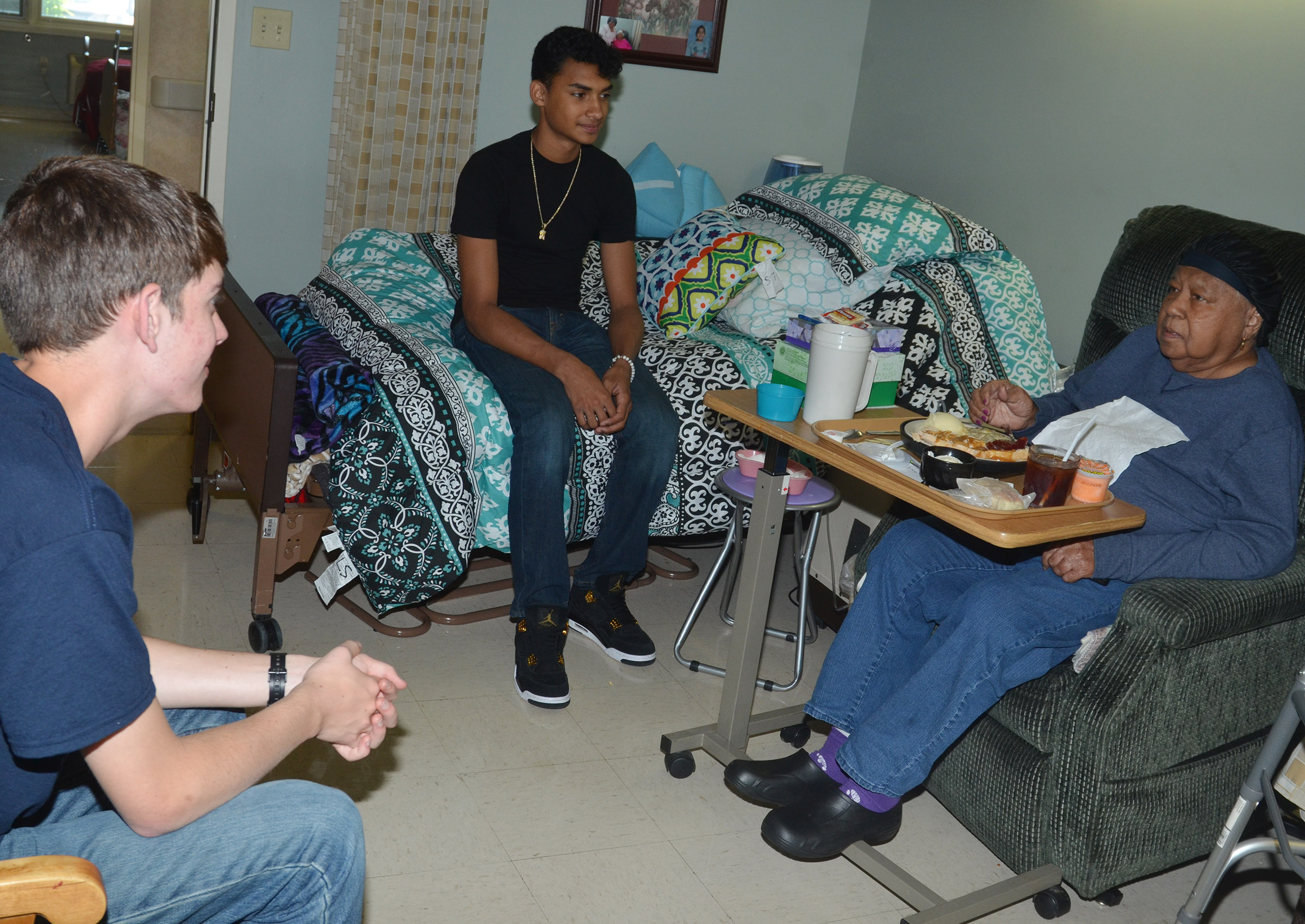 CHS seniors Murphy Lamb, at left, and Daniel Silva visit with Grandview residents.