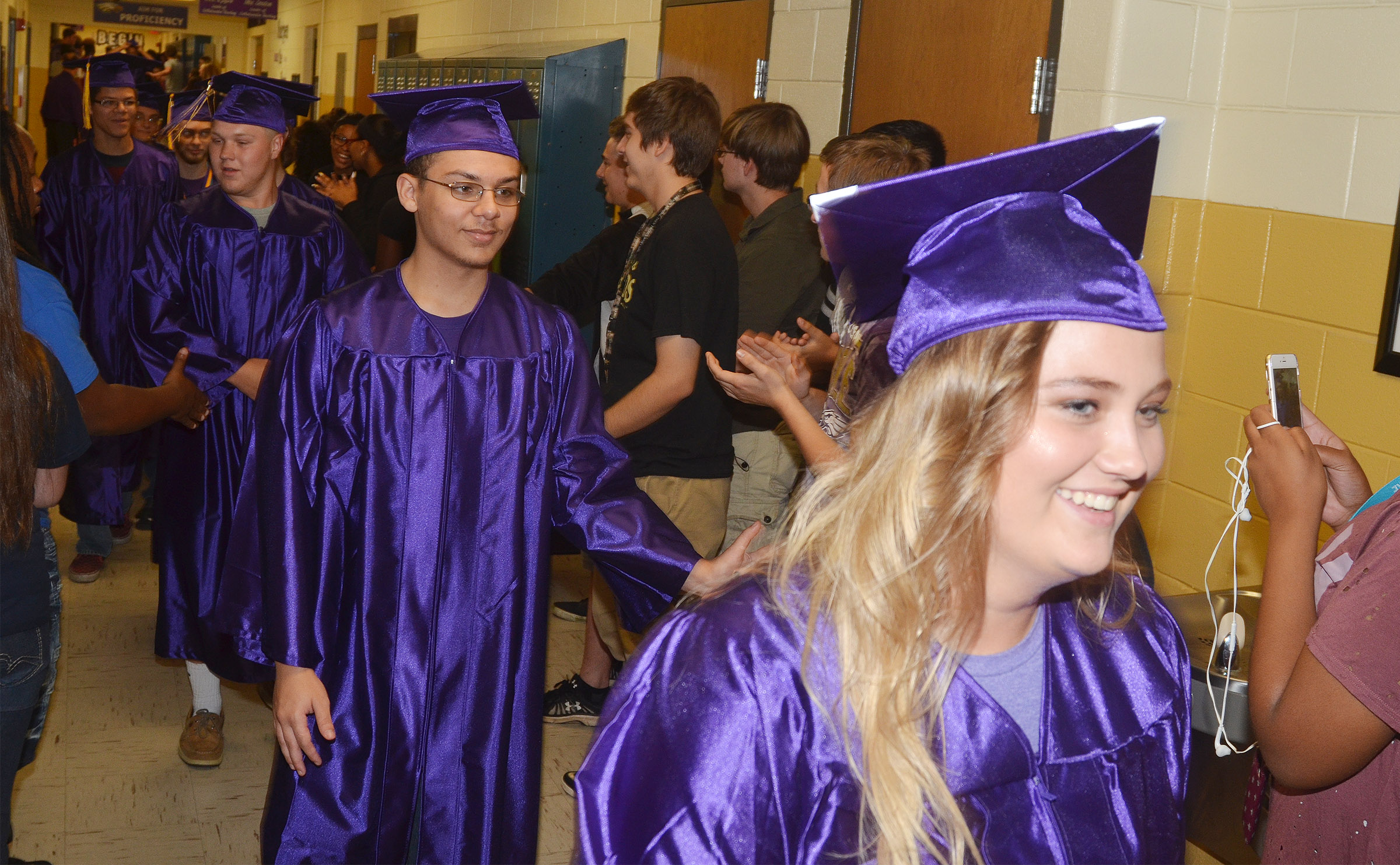 CHS senior Michael Porter, at left, and Brenna Wethington walk down the hallways at CHS with their classmates.