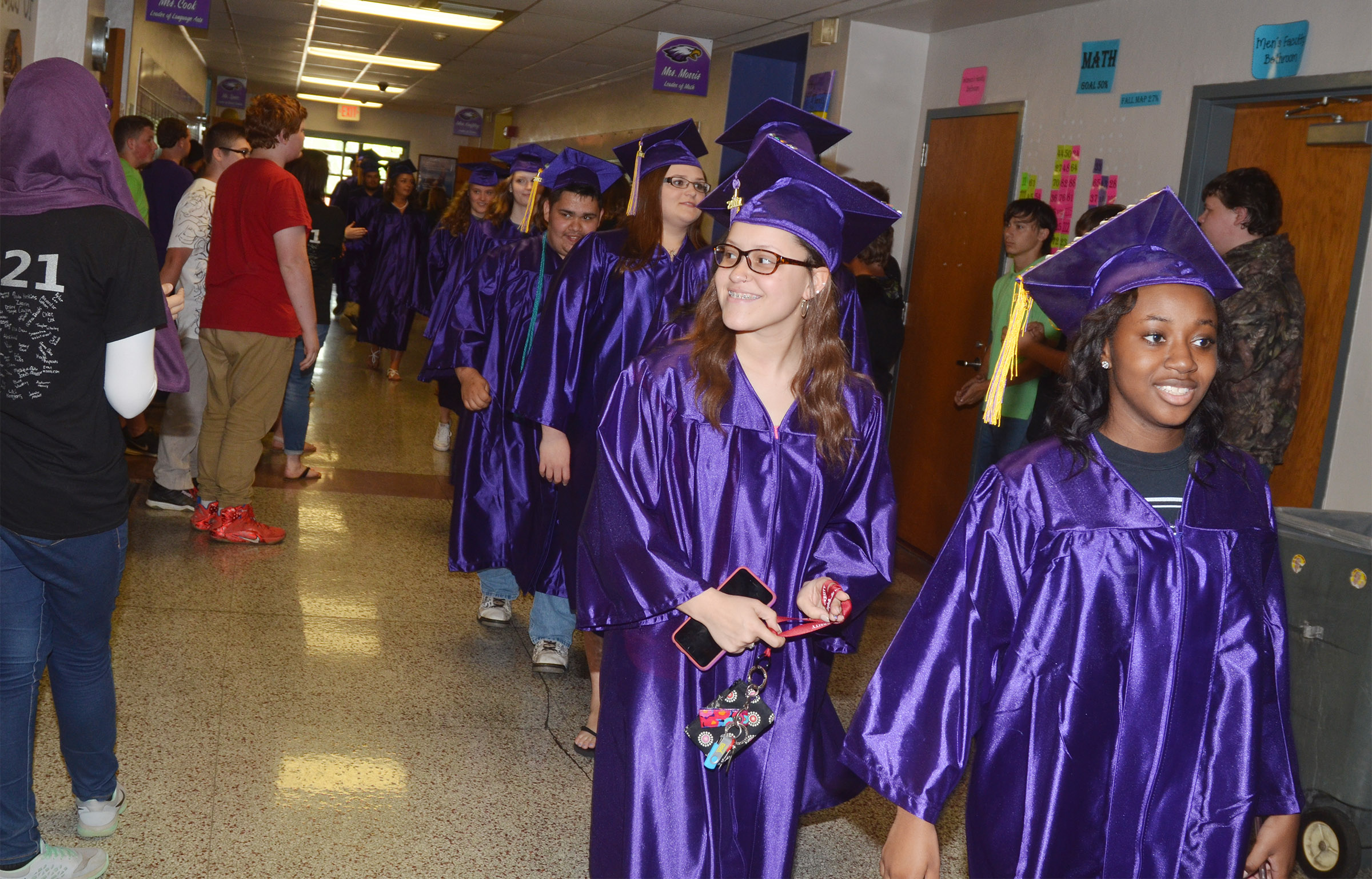 CHS seniors Breanna Spaulding, at left, and Latavia Shively walk down the CMS hallways.