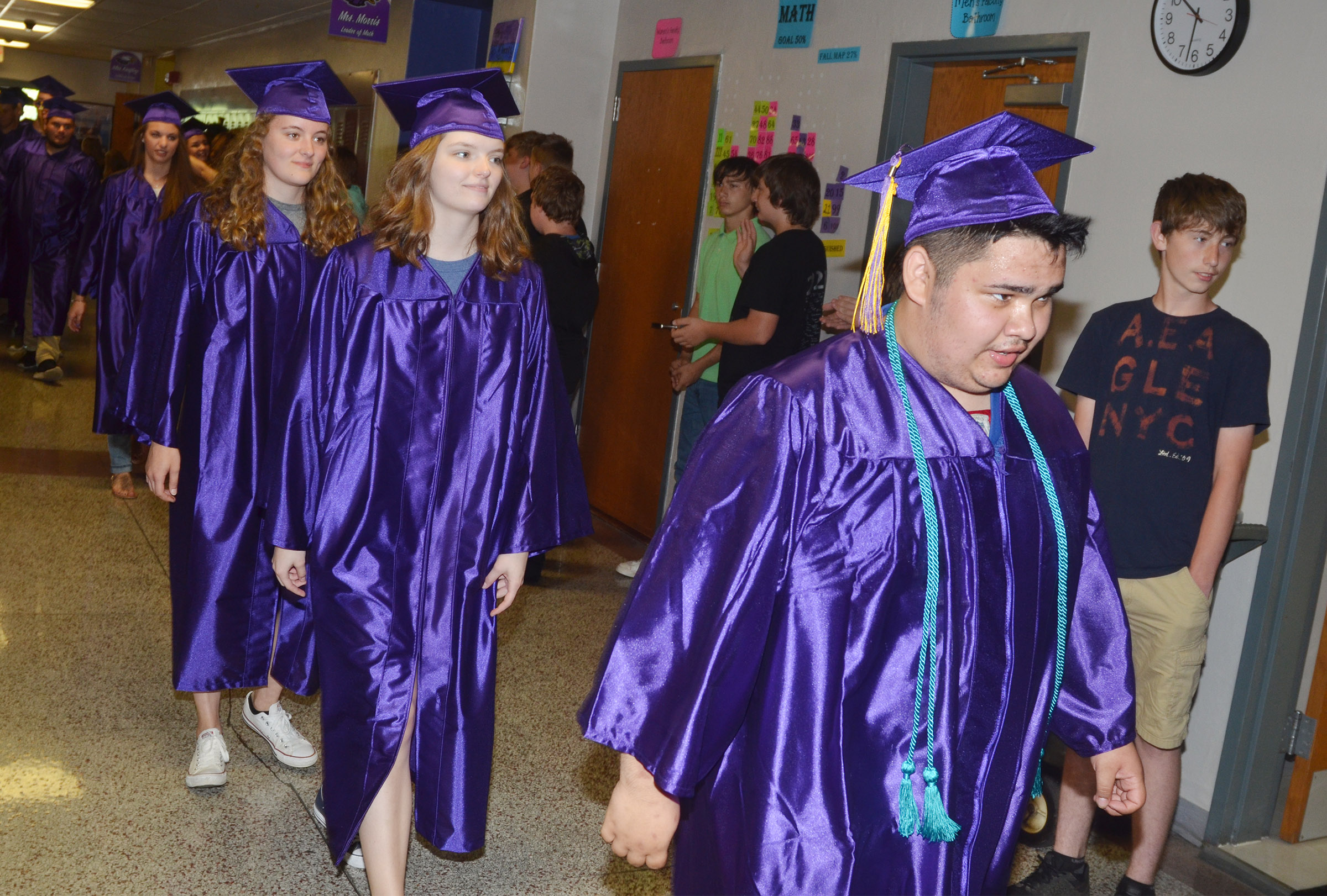 From left, CHS seniors Caroline McMahan, Blair Lamb and Robert Tungate walk down the hallways at CMS with their classmates.