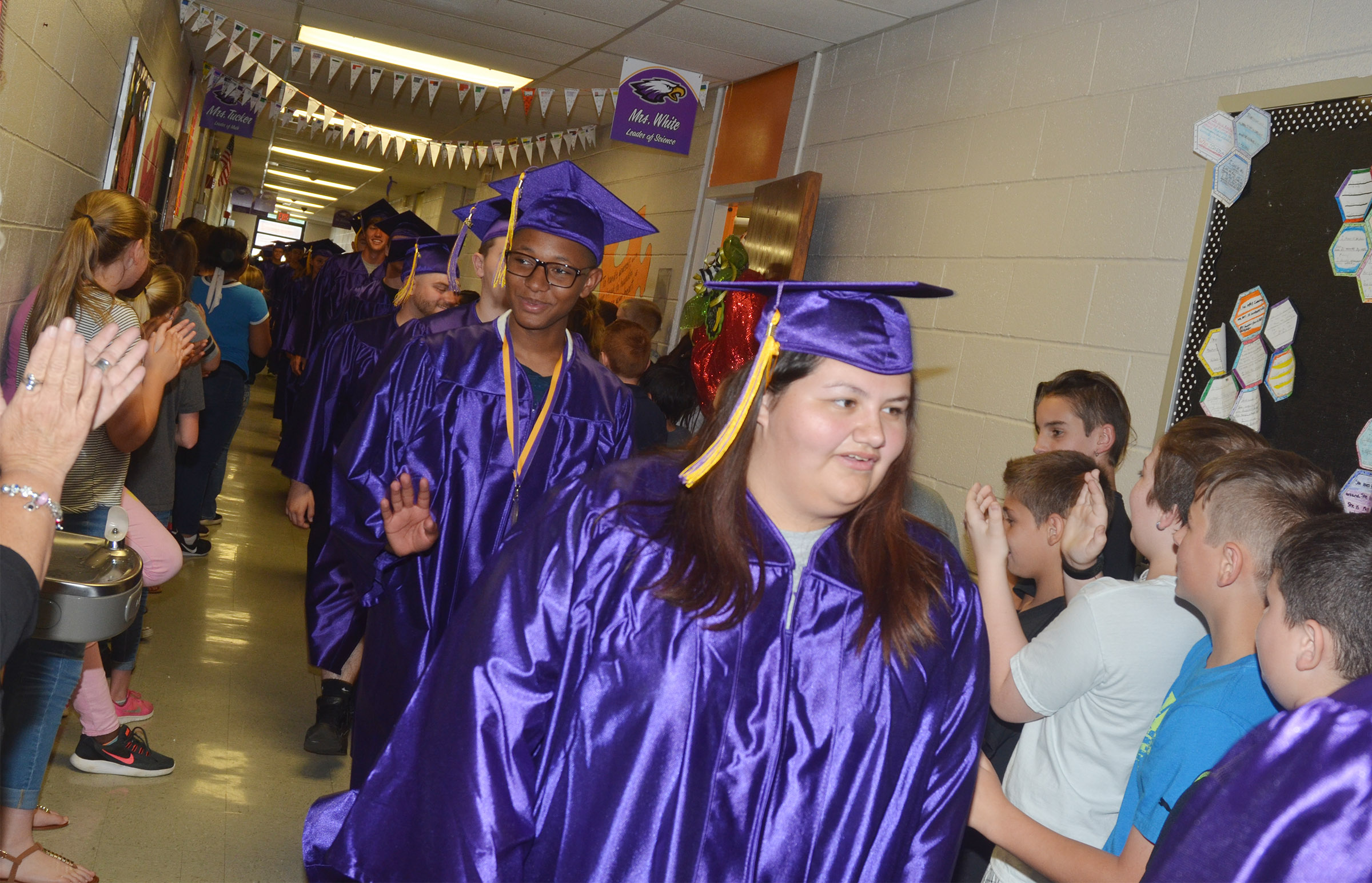 CHS seniors Jaleel Cowan, at left, and Laura May Gutierrez walk down the CMS hallways with their classmates.