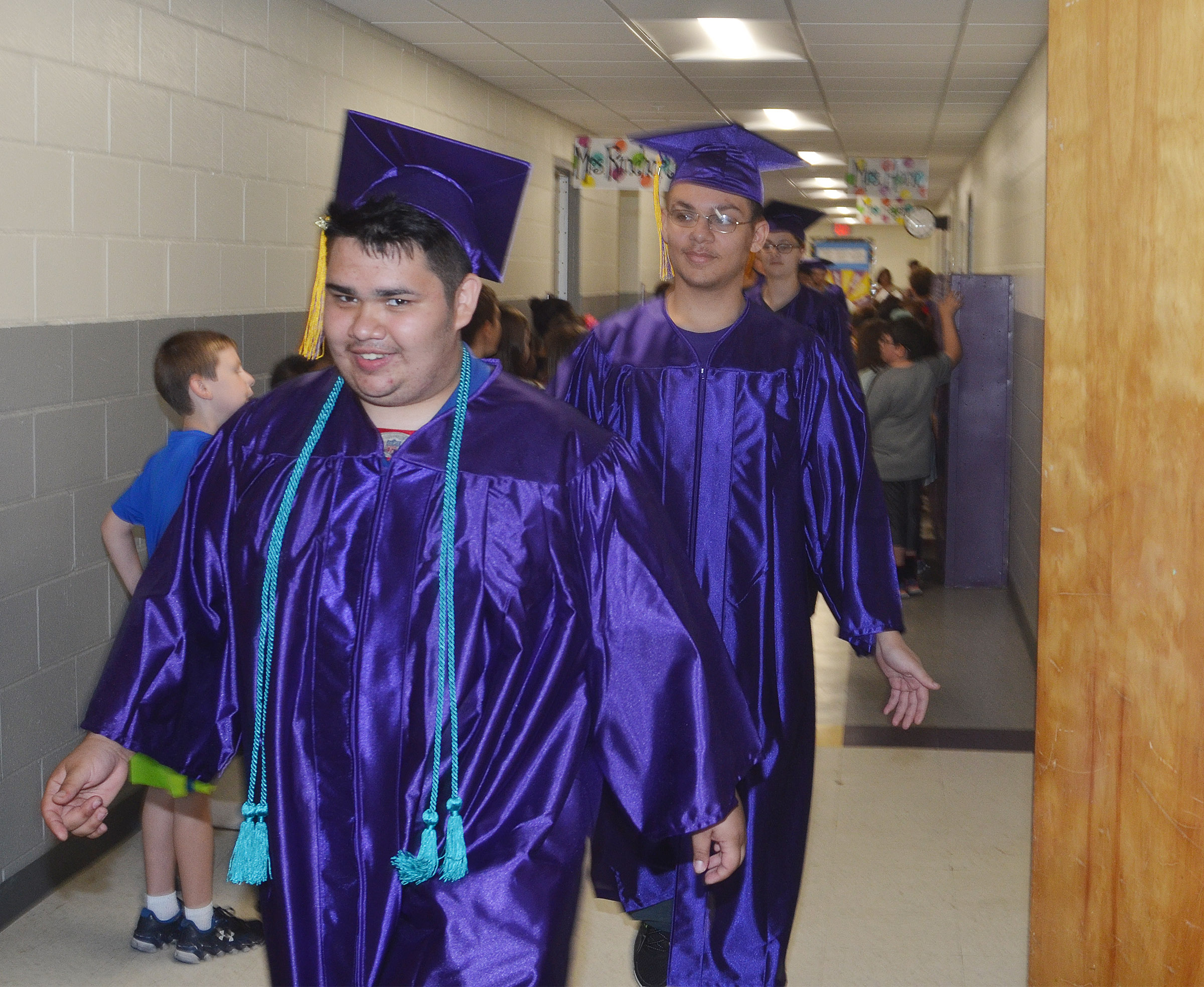 CHS senior Robert Tungate and his classmates walk down the hallways at CES.