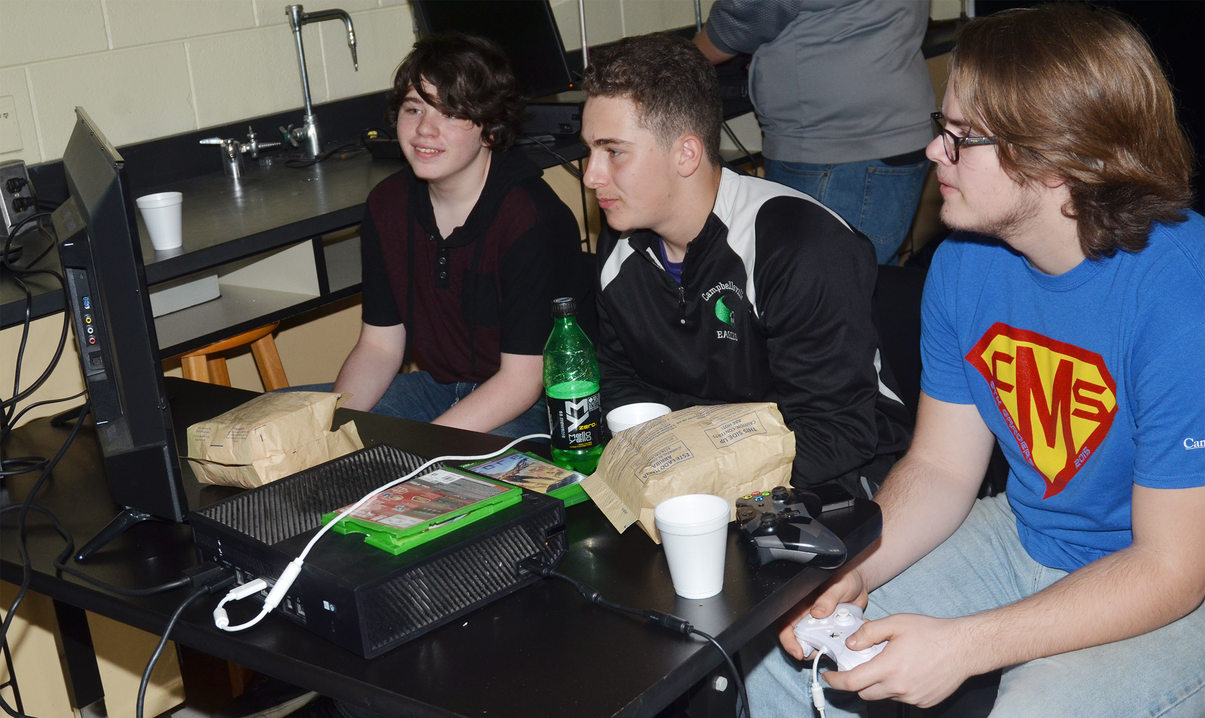 From left, CHS sophomores Lathan Vincent, Brody Weeks and John Netherland play video games.