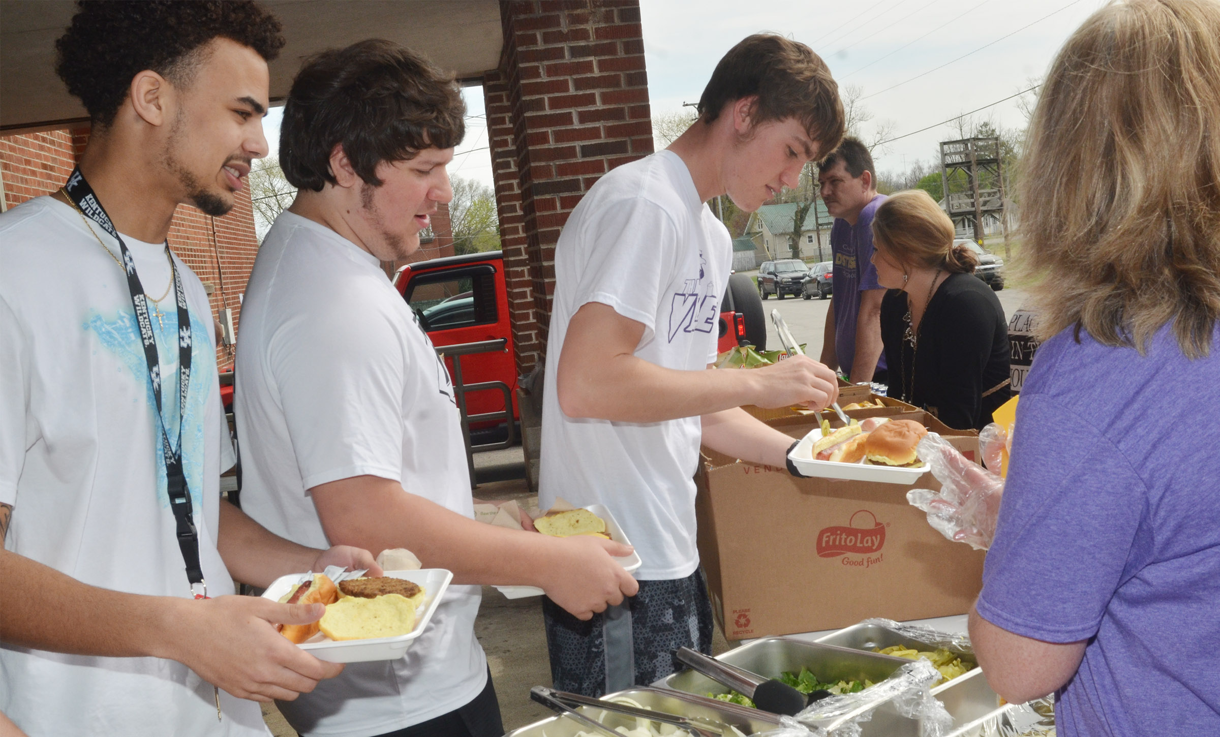 CHS seniors, from left, Arick Groves, Donnie Osinger and Zack Bottoms eat lunch.