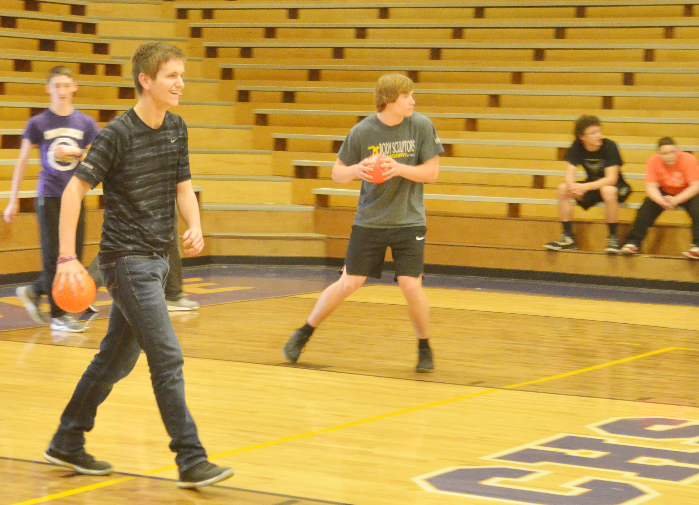 CHS sophomores Myles Murrell, at left, and Tristan Johnson play dodgeball.