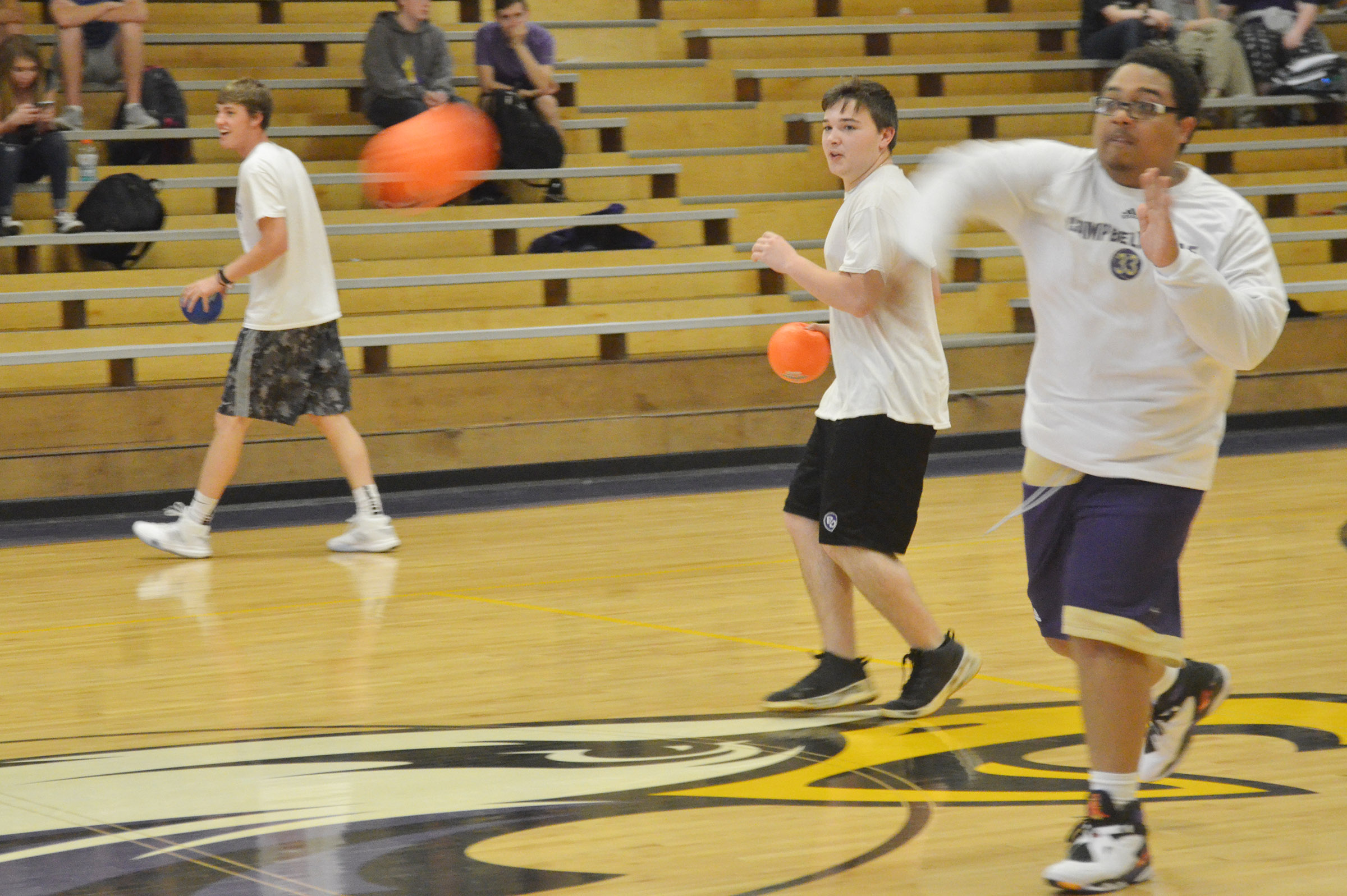From left, CHS seniors Zack Bottoms, Phoenix Burchett and Ricky Smith-Cecil play dodgeball.