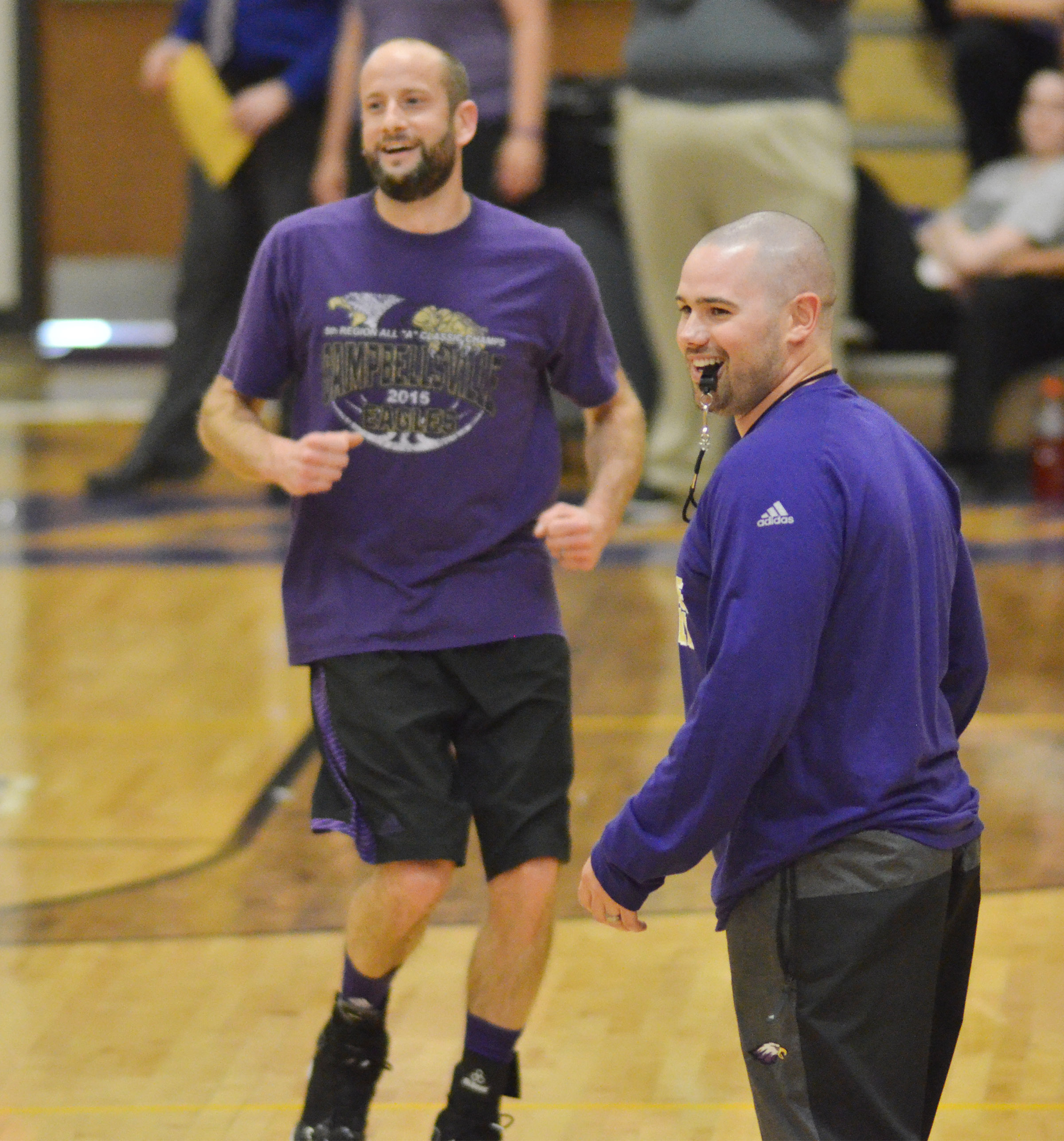 CHS teachers Ben Davis, at left, and Blake Milby smile as a member of the teacher's team scores a basket.