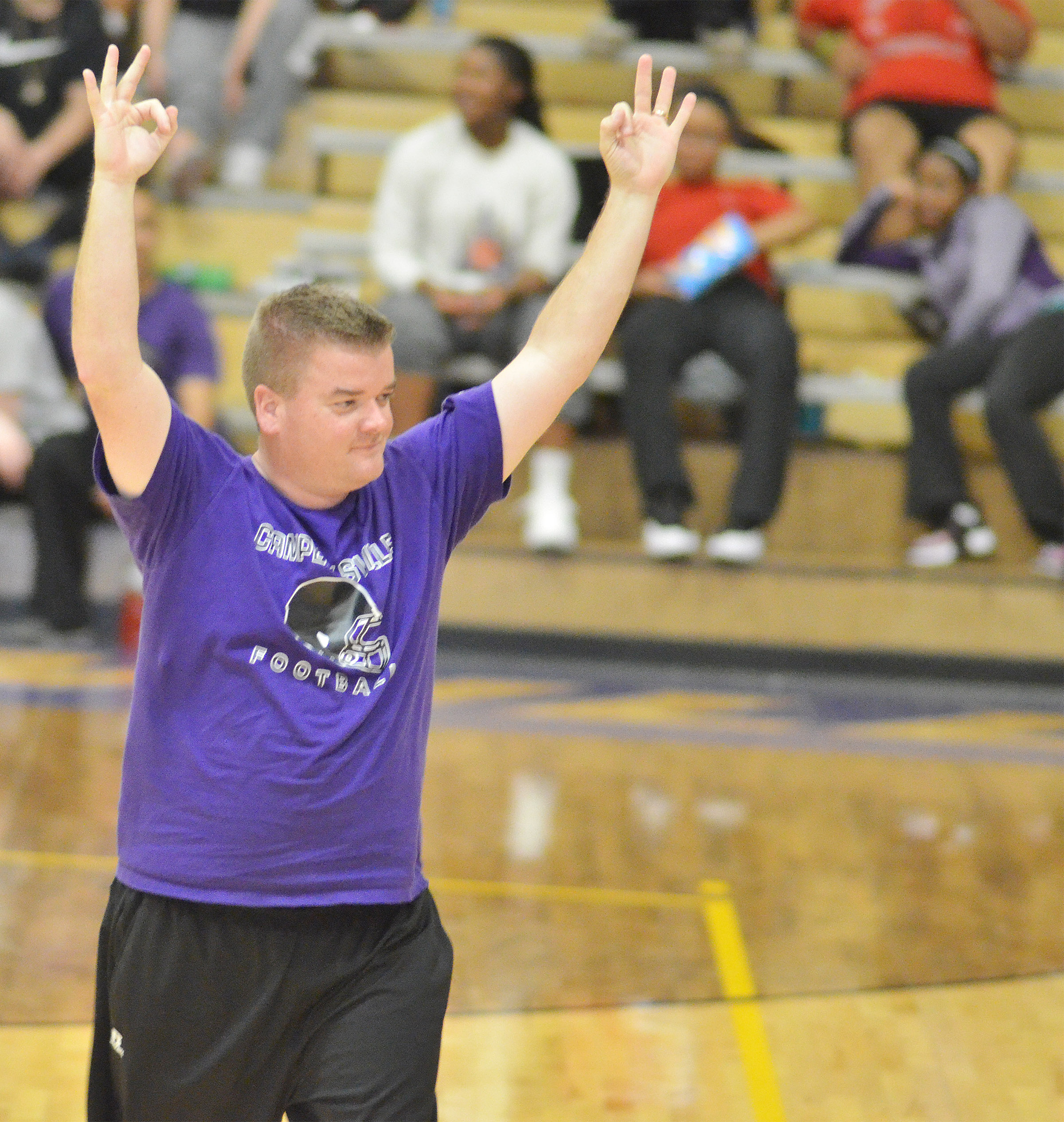 CHS teacher Dale Estes celebrates after his teammate makes a three-point shot.