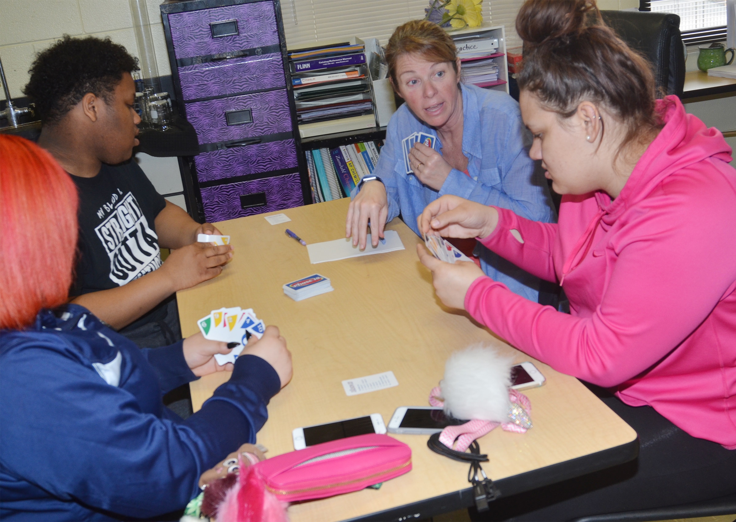 CHS teacher Dee Doss plays Phase 10 with juniors Darius Wright, at left, and Jayden Bridgewater.