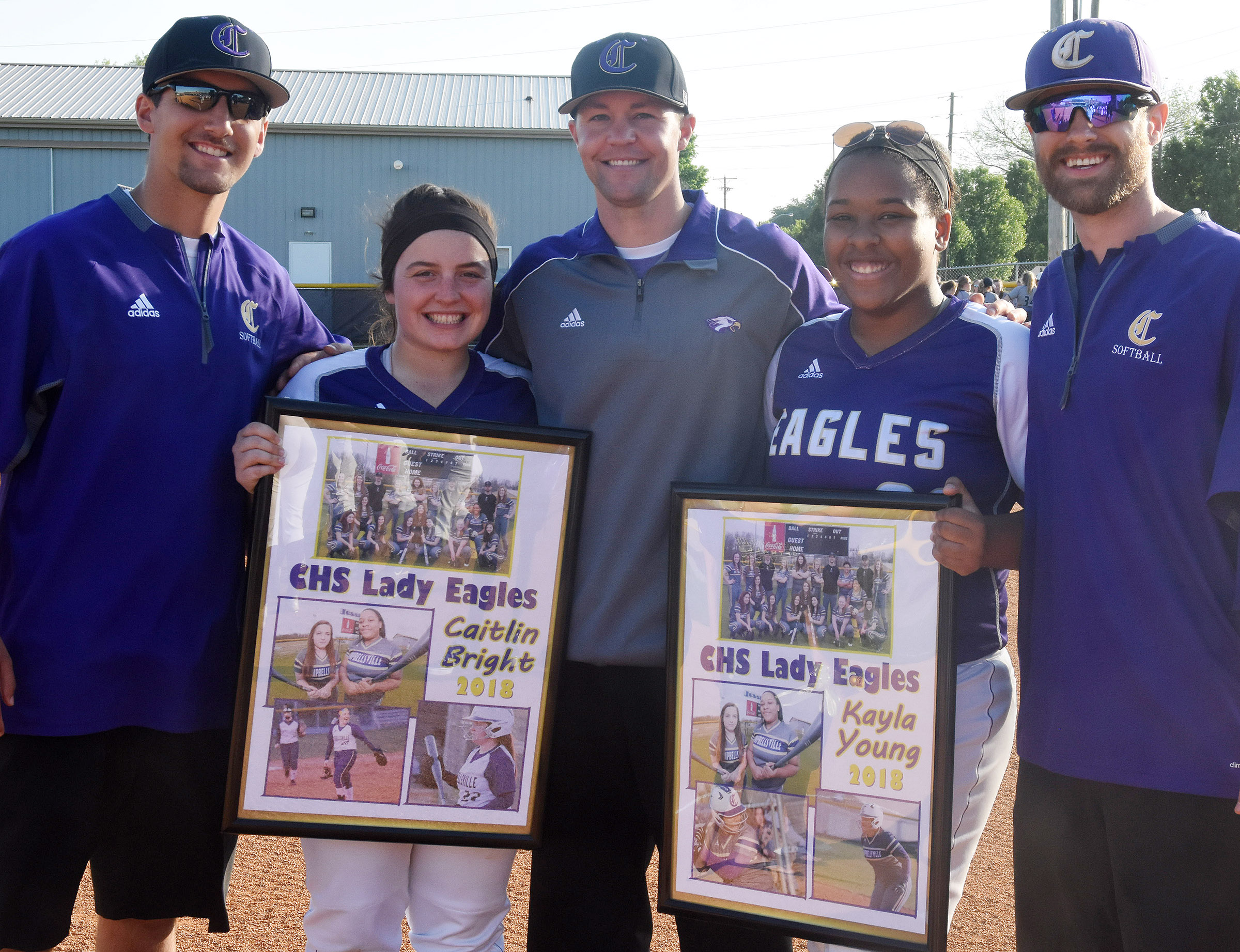 CHS seniors Caitlin Bright, at left, and Kayla Young are honored for their dedication to the Lady Eagles program. They are pictured with, from left, assistant coach Zach Durham, head coach Weston Jones and assistant coach Matthew Schmuck.