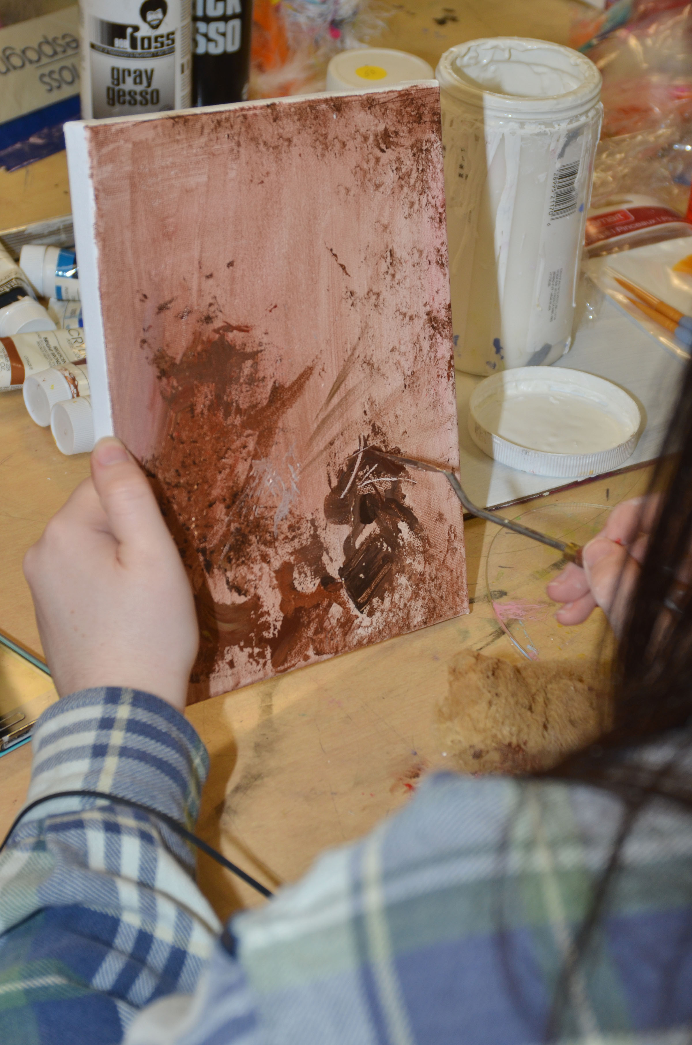 CHS specialized art student Tiffany Stagner, a senior, adds texture to her painting.