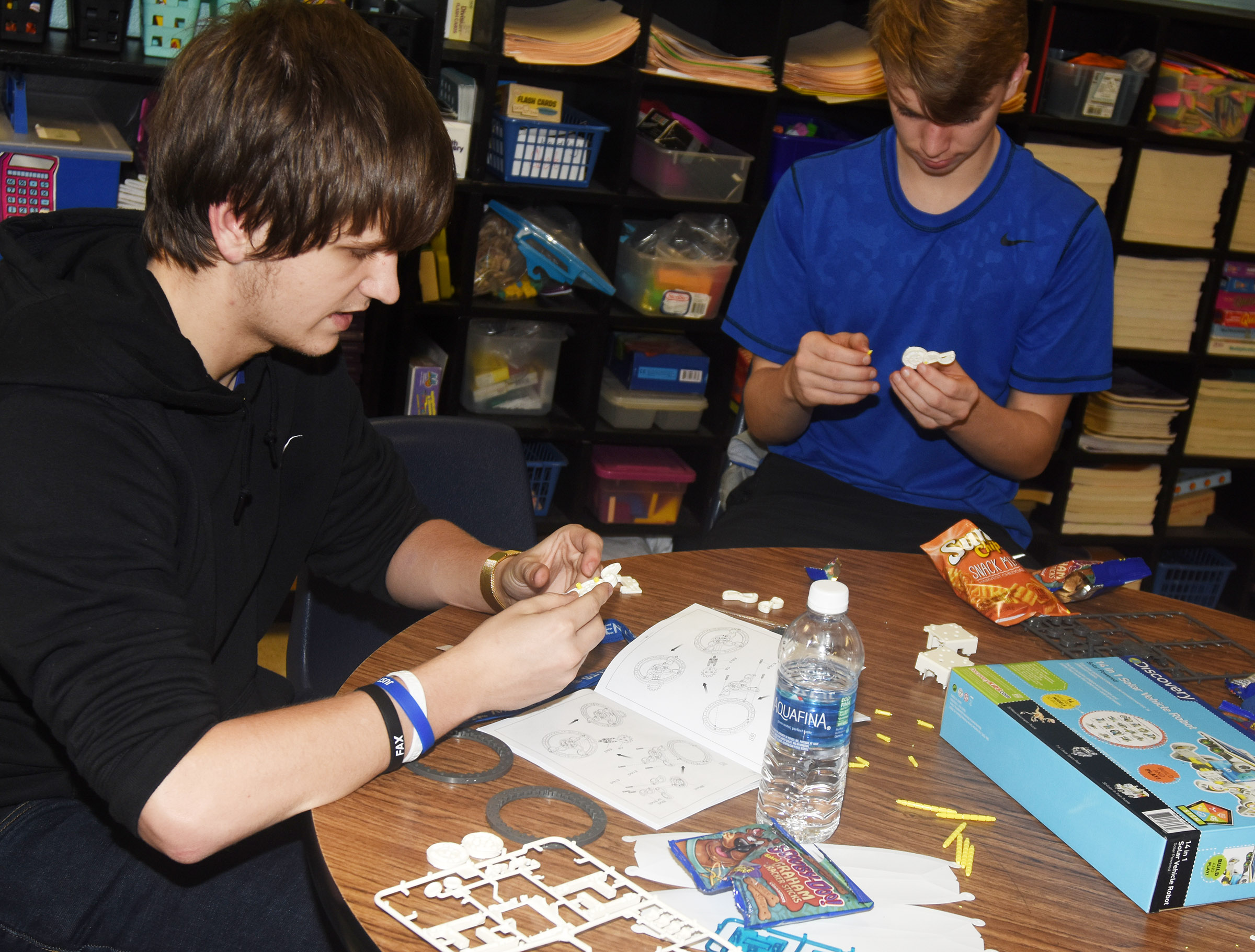 CHS junior Myles Murrell, at left, and freshman Arren Hash work together to build a solar vehicle robot.