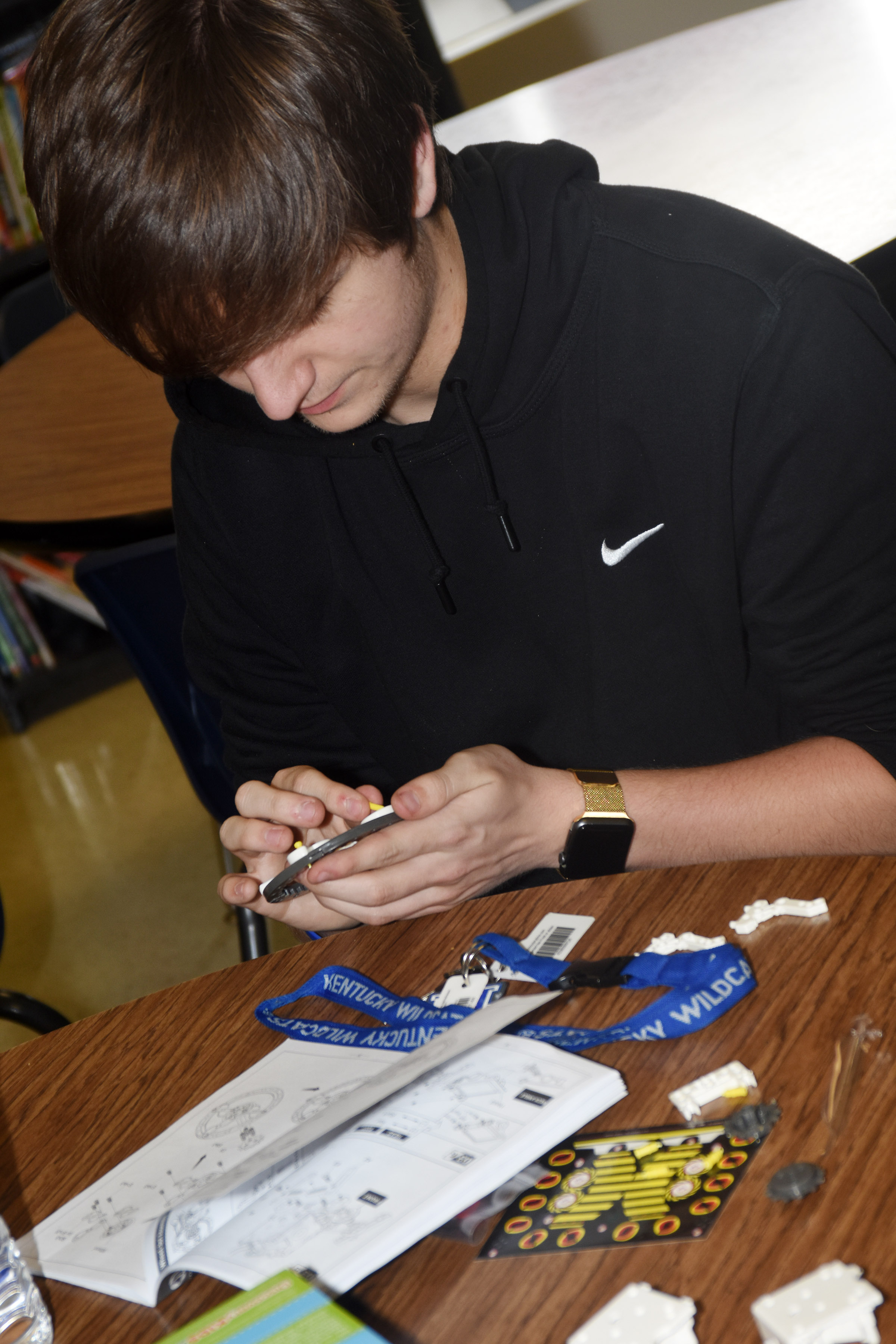 CHS junior Myles Murrell and his fellow STEM Club members build a solar vehicle robot.