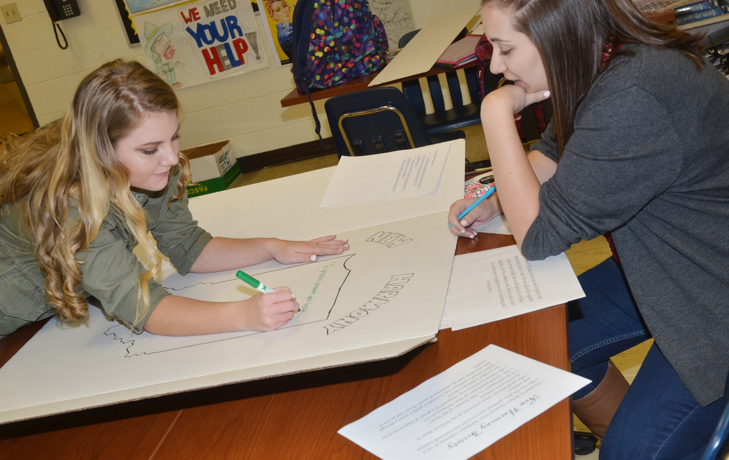 CHS juniors Hayley Stapleton, at left, and Elizabeth Sullivan work on a project together.