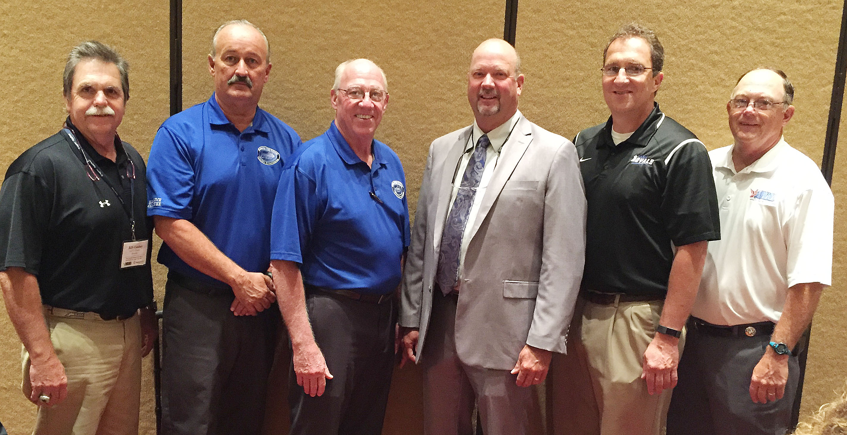 Campbellsville High School boys' head basketball coach and athletic director Tim Davis was inducted into the National High School Athletic Coaches Association Hall of Fame on Tuesday, June 20, for his longevity and service to high school athletics. Above, Davis, fourth from left, is pictured with the Kentucky High School Coaches Association executive committee members, who chose him for the honor.