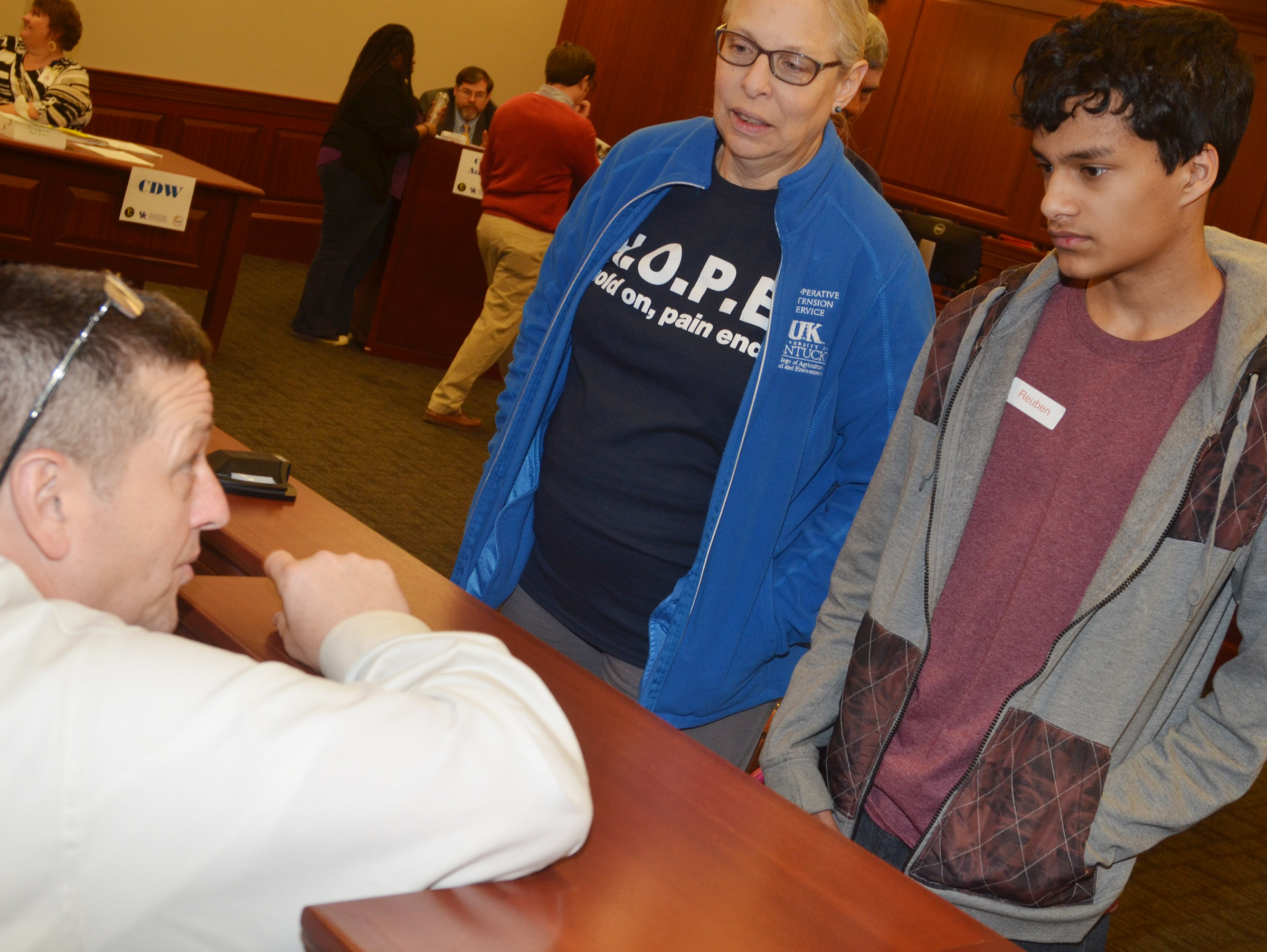 "CHS freshman Ben Arachi and his ""mother"" Angie Freeman of the Taylor County Extension Office talk to CHS Assistant Principal Mark Kearney as part of the ""Truth or Consequences"" scenario."