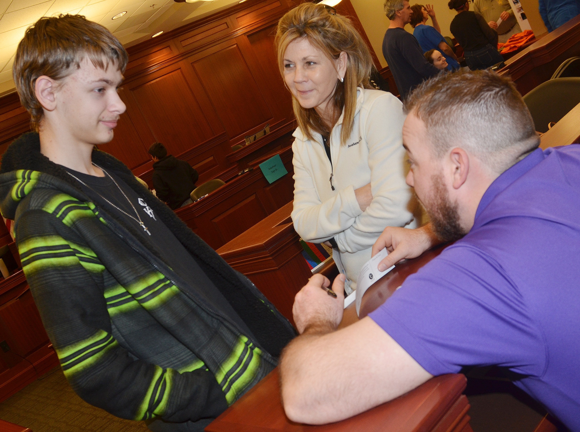 "CHS freshman Kristopher Releford and his ""mother"" Amy Deaton, a special education teacher at CHS, talk to youth pastor Brett Sowell about the religious implications of his actions as part of the ""Truth or Consequences"" scenario."