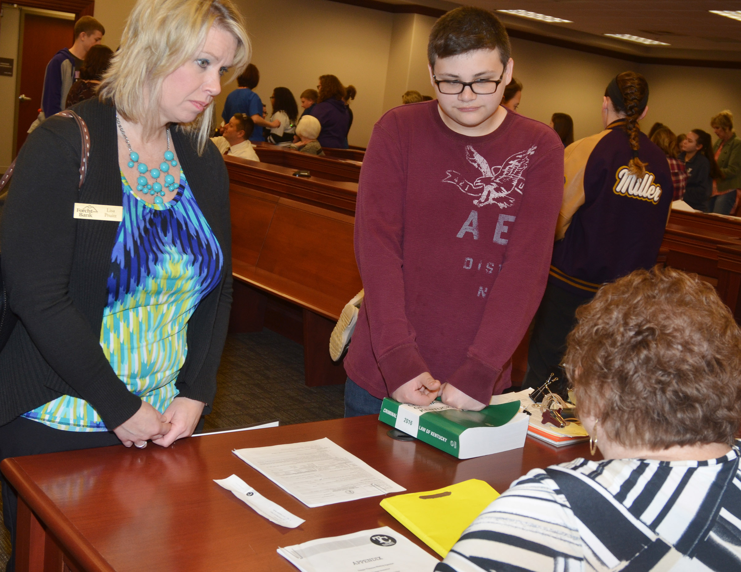 "CHS freshman Gabriel Gutierrez and his ""mother"" Lisa Pruitt of Forcht Bank talk with a Court Designated Worker as part of the ""Truth or Consequences"" scenario."