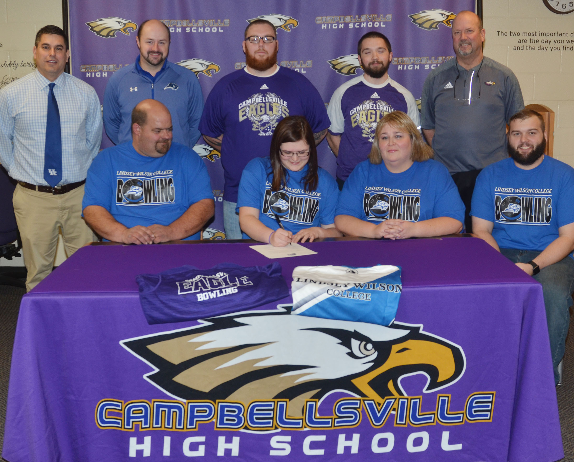 Campbellsville High School senior Vera Brown will continue her academic and bowling career at Lindsey Wilson College in the fall. She officially signed her letter of intent in a special ceremony on Wednesday, Feb. 1. From left, front, are her father Shannon Brown, Vera, her mother Tonya Tate, and stepfather Andrew Tate. Back, CHS Principal Kirby Smith, LWC bowling coach Brandon Burns, CHS head bowling coach Stephen Tucker, CHS assistant bowling coach Dakota Pendleton and CHS Athletic Director Tim Davis.