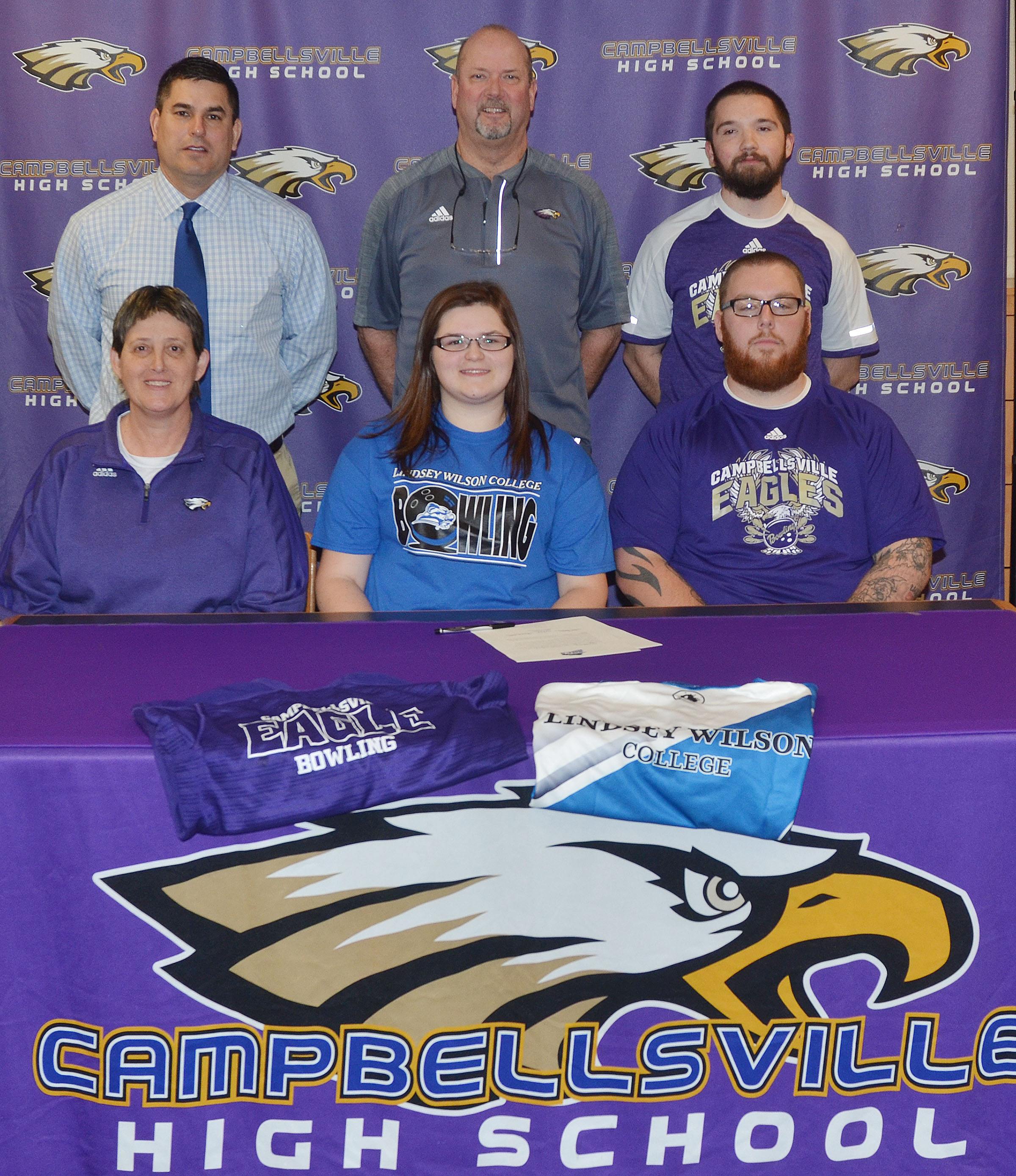 Campbellsville High School senior Vera Brown will continue her academic and bowling career at Lindsey Wilson College in the fall. She officially signed her letter of intent in a special ceremony on Wednesday, Feb. 1. From left, front, are CHS Assistant Athletic Director Katie Wilkerson, Vera, and CHS head bowling coach Stephen Tucker. Back, CHS Principal Kirby Smith, CHS Athletic Director Tim Davis and CHS assistant bowling coach Dakota Pendleton.