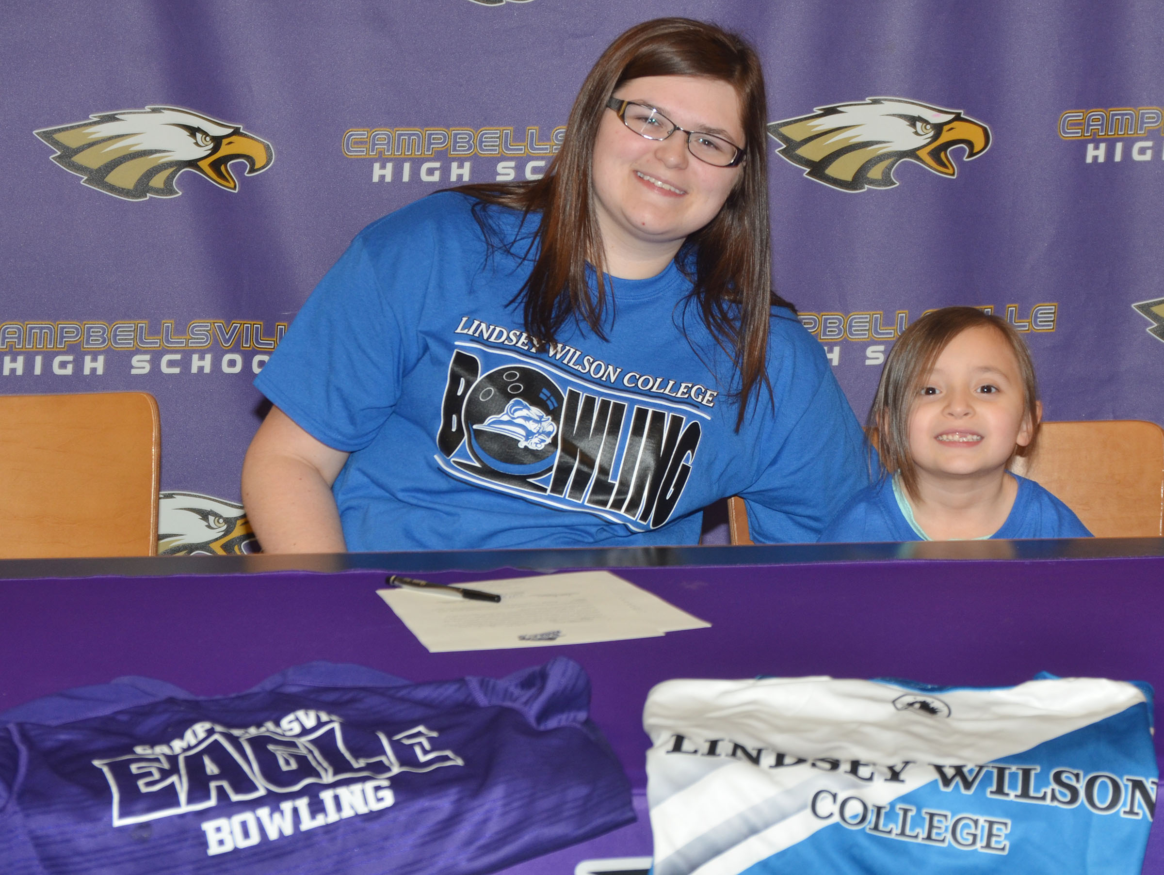 Campbellsville High School senior Vera Brown will continue her academic and bowling career at Lindsey Wilson College in the fall. She officially signed her letter of intent in a special ceremony on Wednesday, Feb. 1. She is pictured with her cousin, Gabriella Tate, who is a kindergartener at Campbellsville Elementary School.