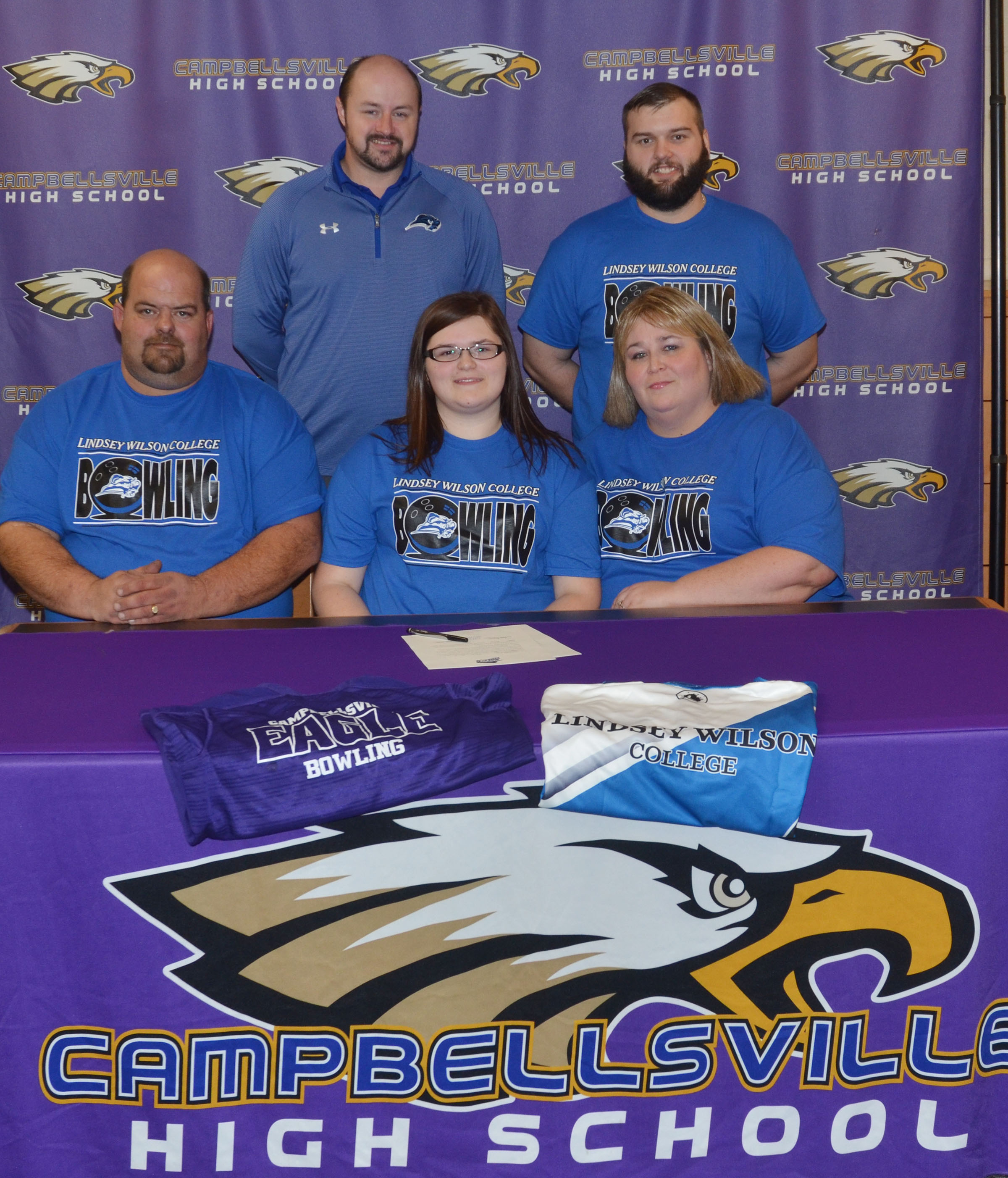 Campbellsville High School senior Vera Brown will continue her academic and bowling career at Lindsey Wilson College in the fall. She officially signed her letter of intent in a special ceremony on Wednesday, Feb. 1. She is pictured with her parents, from left, front, father Shannon Brown and mother Tonya Tate. Back, LWC bowling coach Brandon Burns and stepfather Andrew Tate.